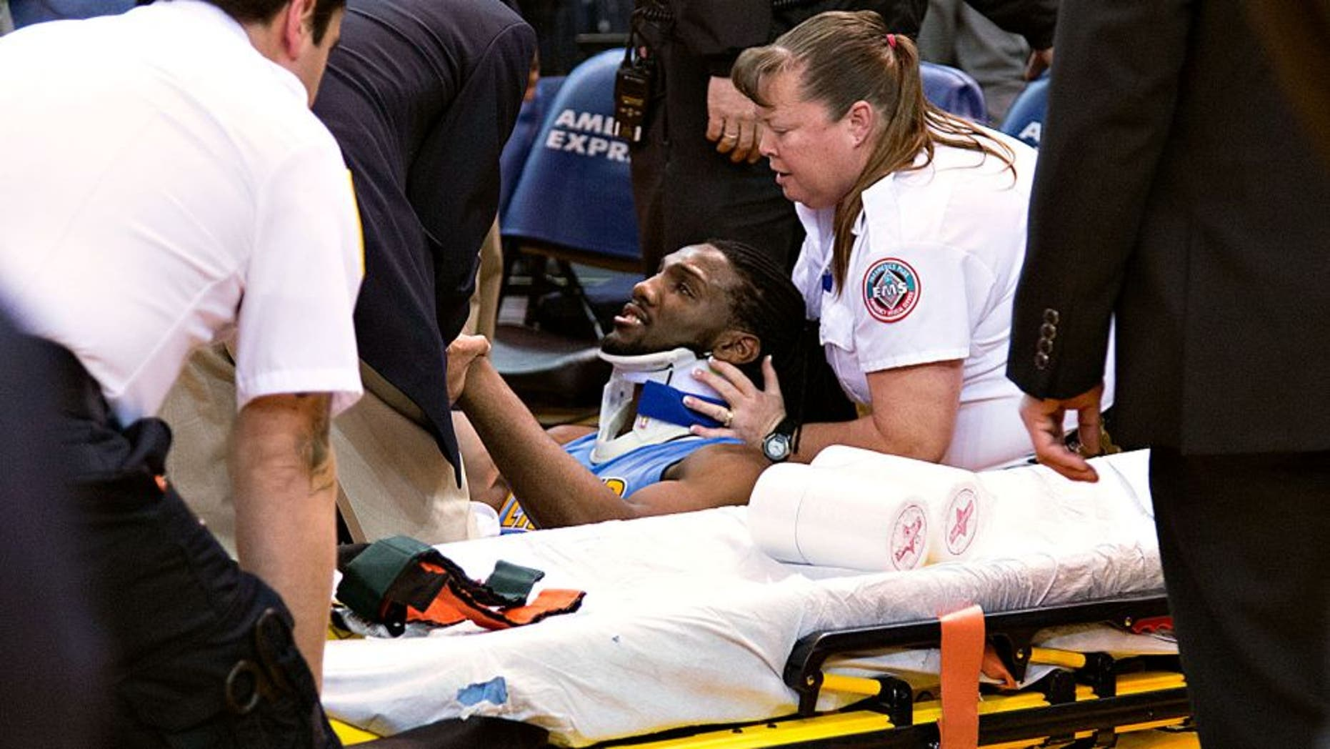 January 2, 2016; Oakland, CA, USA; Denver Nuggets forward Kenneth Faried (35) receives medical attention after the game against the Golden State Warriors at Oracle Arena. The Warriors defeated the Nuggets 111-108 in overtime. Mandatory Credit: Kyle Terada-USA TODAY Sports