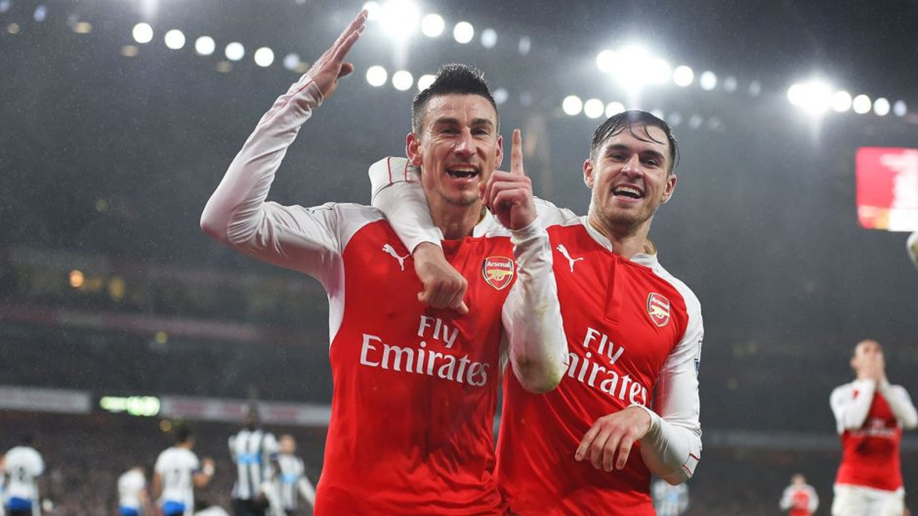LONDON, ENGLAND - JANUARY 02: Laurent Koscielny (L) of Arsenal celebrates scoring his team's first goal with his team mate Aaron Ramsey (R) during the Barclays Premier League match between Arsenal and Newcastle United at Emirates Stadium on January 2, 2016 in London, England. (Photo by Shaun Botterill/Getty Images)