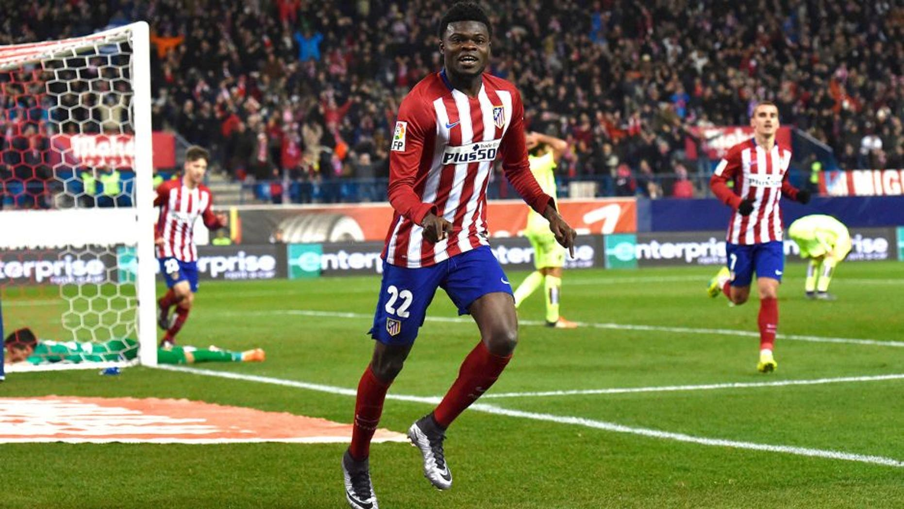 Atletico Madrid's Ghanaian midfielder Thomas Partey celebrates after scoring during the Spanish league football match Club Atletico de Madrid vs Leg vante UD at the Vicente Calderon stadium in Madrid on January 2, 2016. AFP PHOTO/ GERARD JULIEN / AFP / GERARD JULIEN (Photo credit should read GERARD JULIEN/AFP/Getty Images)