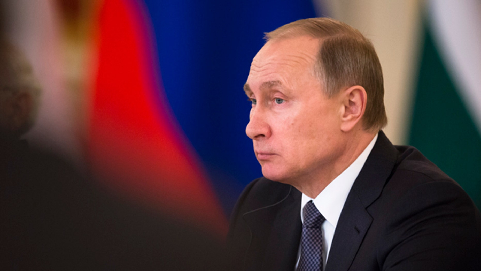 Russian President Vladimir Putin attends a meeting with Russian and Indian officials and businessmen during his meeting with Indian Prime Minister Narendra Modi  in the Kremlin in Moscow, Thursday, Dec. 24, 2015. (AP Photo/Pavel Golovkin)