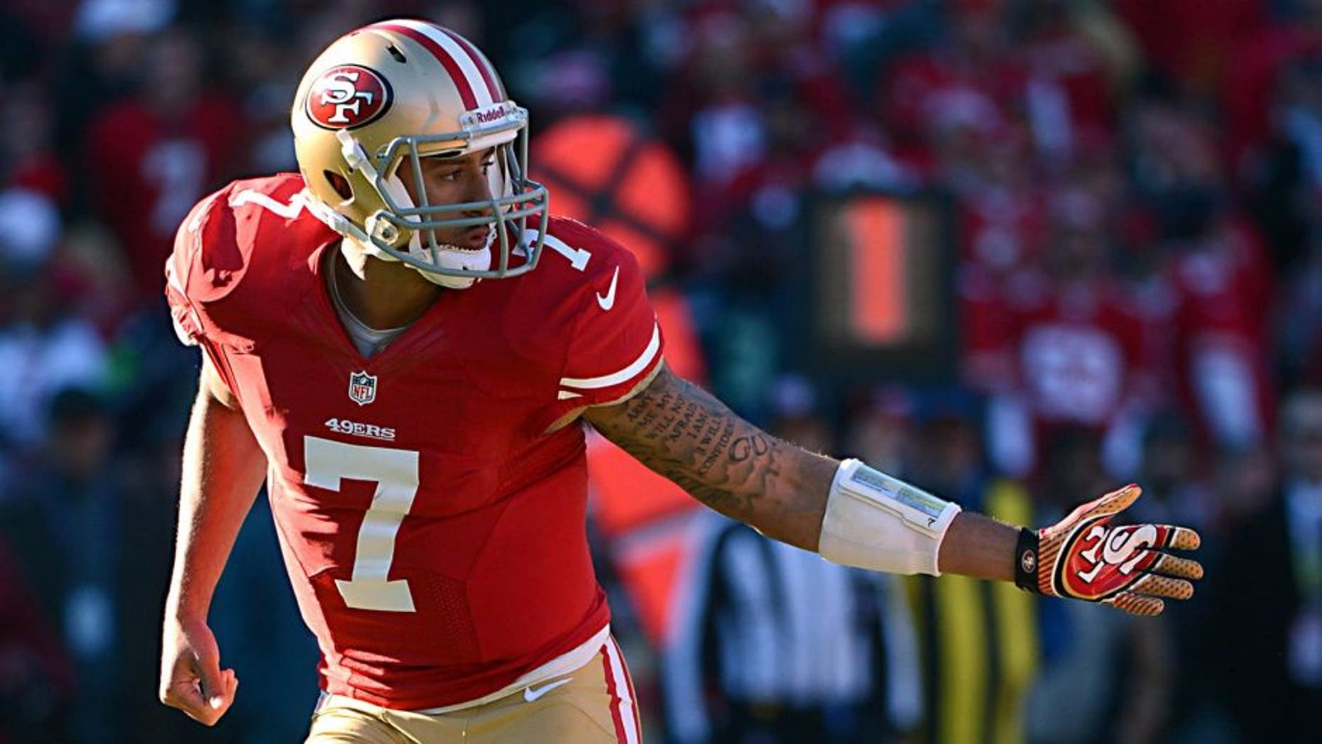 December 8, 2013; San Francisco, CA, USA; San Francisco 49ers quarterback Colin Kaepernick (7) follows through after handing the football off during the second quarter against the Seattle Seahawks at Candlestick Park. The 49ers defeated the Seahawks 19-17. Mandatory Credit: Kyle Terada-USA TODAY Sports