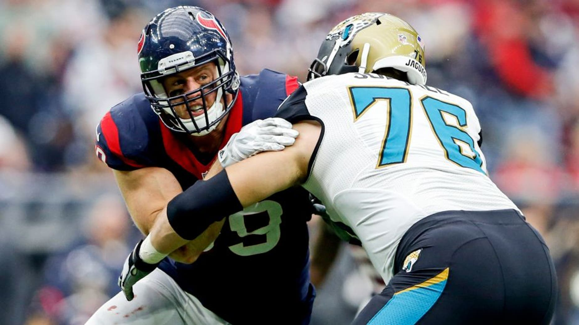 Jan 3, 2016; Houston, TX, USA; Houston Texans defensive end J.J. Watt (99) rushes against Jacksonville Jaguars tackle Luke Joeckel (76) during the game at NRG Stadium. Houston won 30-6. Mandatory Credit: Kevin Jairaj-USA TODAY Sports