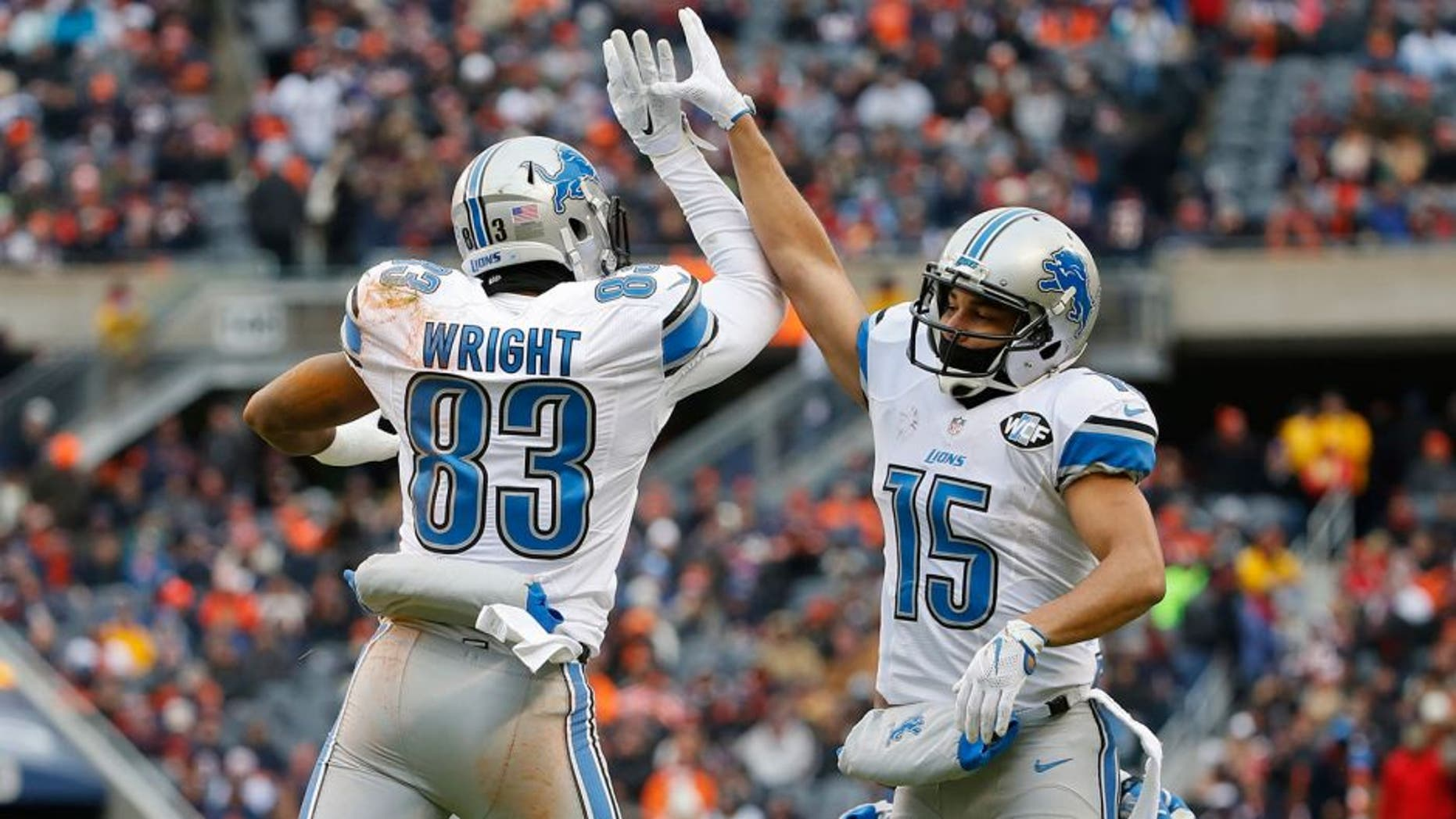 Jan 3, 2016; Chicago, IL, USA; Detroit Lions tight end Timothy Wright (83) celebrates with wide receiver Golden Tate (15) after scoring a touchdown against the Chicago Bears during the first half at Soldier Field. Mandatory Credit: Kamil Krzaczynski-USA TODAY Sports