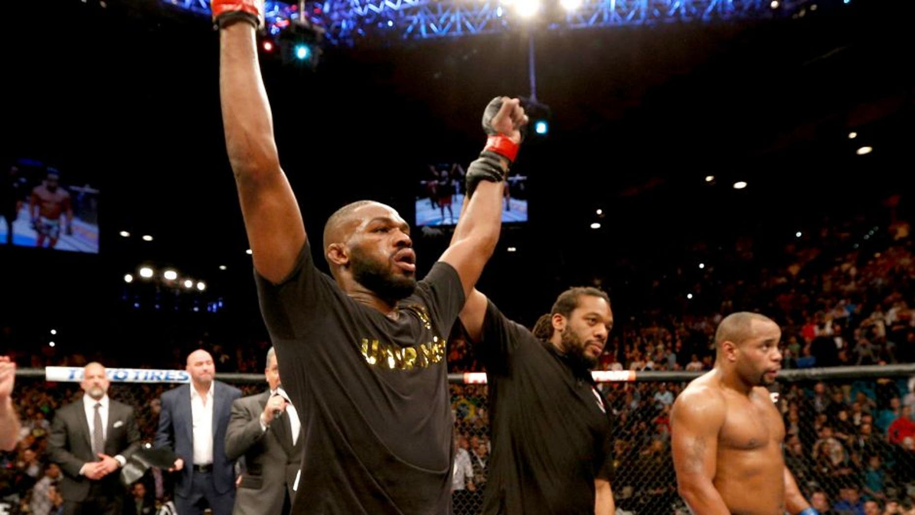 LAS VEGAS, NV - JANUARY 03: UFC light heavyweight champion Jon Jones (L) celebrates his win over Daniel Cormier (R) in their UFC light heavyweight championship bout during the UFC 182 event at the MGM Grand Garden Arena on January 3, 2015 in Las Vegas, Nevada. (Photo by Josh Hedges/Zuffa LLC/Zuffa LLC via Getty Images)