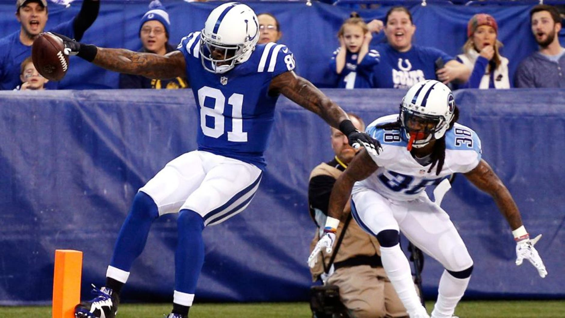 Jan 3, 2016; Indianapolis, IN, USA; Indianapolis Colts wide receiver Andre Johnson (81) catches a pass for a touchdown against Tennessee Titans cornerback B.W. Webb (38) at Lucas Oil Stadium. Mandatory Credit: Brian Spurlock-USA TODAY Sports