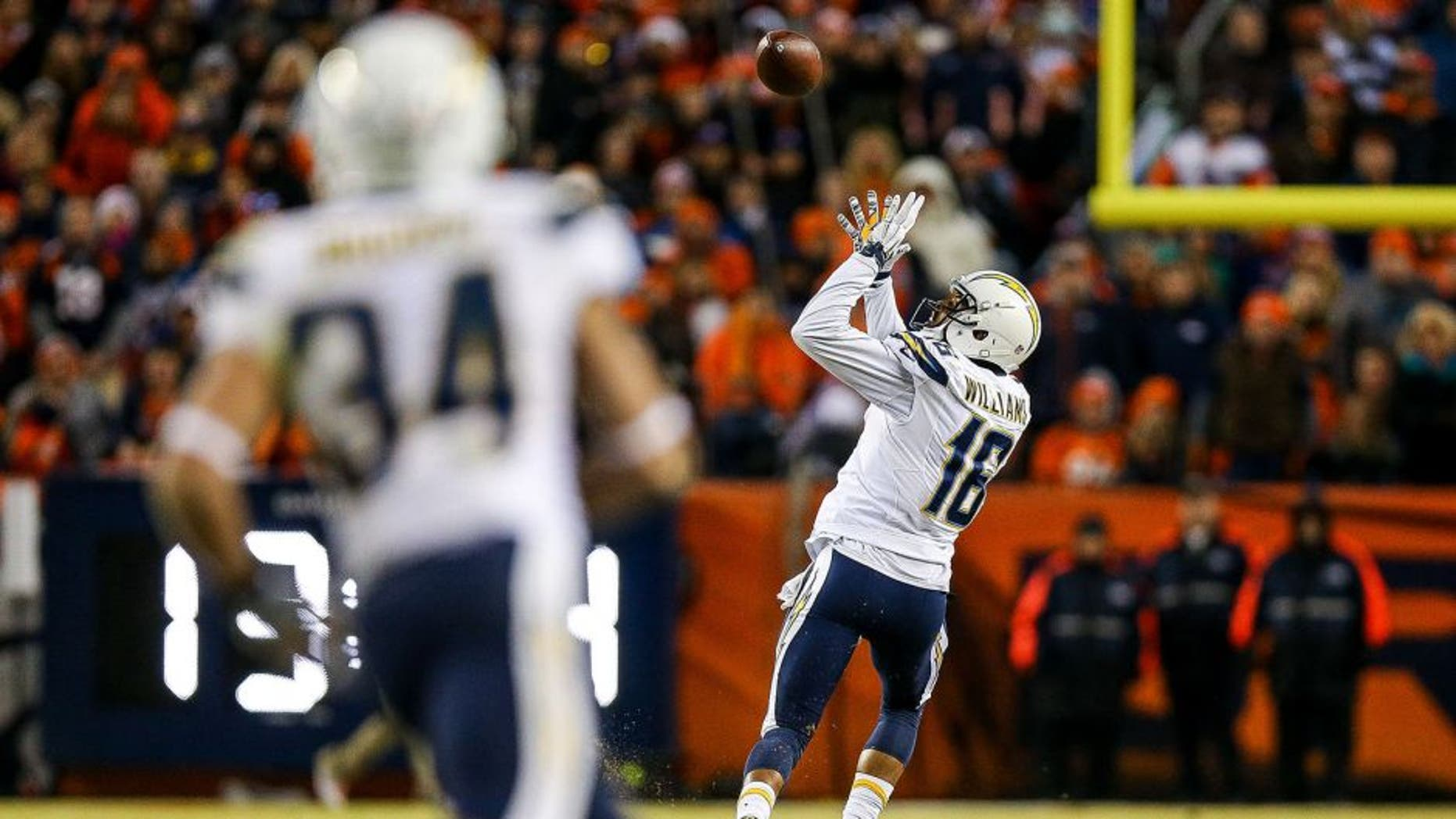 DENVER, CO - JANUARY 3: Wide receiver Tyrell Williams #16 of the San Diego Chargers catches a pass for an 80-yard touchdown against the Denver Broncos in the fourth quarter of a game at Sports Authority Field at Mile High on January 3, 2016 in Denver, Colorado. The catch was the first of Williams' NFL career. (Photo by Justin Edmonds/Getty Images)
