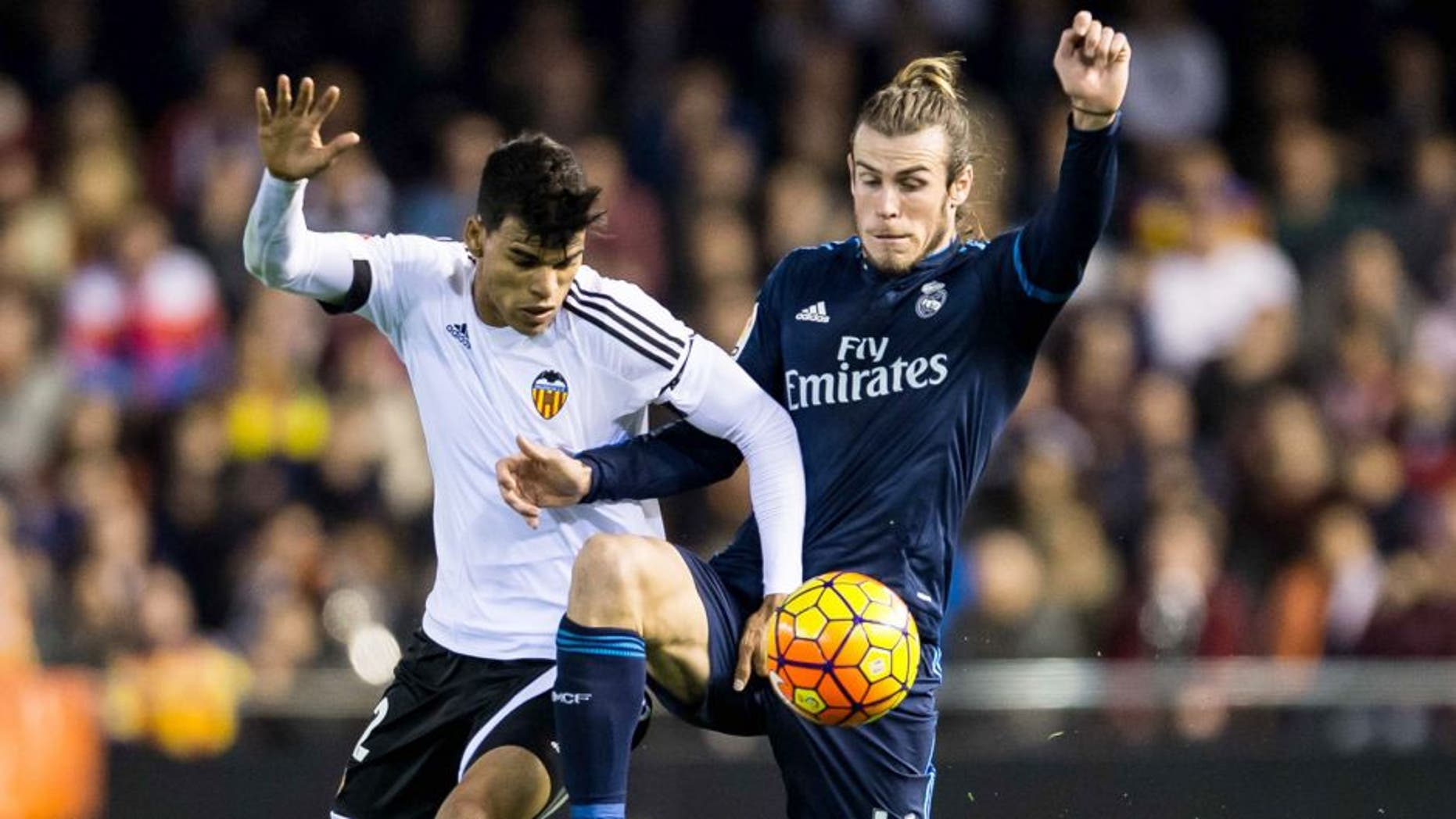 VALENCIA, SPAIN - JANUARY 03: Danilo of Valencia CF (L) competes for the ball with Gareth Bale of Real Madrid CF (R) during the Valencia CF vs Real Madrid CF as part of the Liga BBVA 2015-2016 at Estadi de Mestalla on January 3, 2016 in Valencia, Spain. (Photo by Aitor Colomer/Power Sport Images/Getty Images)