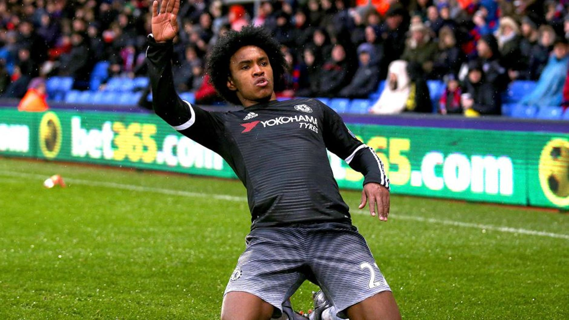 LONDON, ENGLAND - JANUARY 03: Willian of Chelsea celebrates after scoring his team's second goal during the Barclays Premier League match between Crystal Palace and Chelsea at Selhurst Park on January 3, 2016 in London, England. (Photo by Ian Walton/Getty Images)
