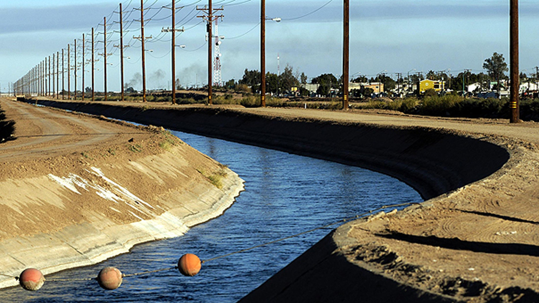 In this Dec. 30, 2002 file photo, the All-American Canal runs along the United States border with Mexico near Calexico, Calif.