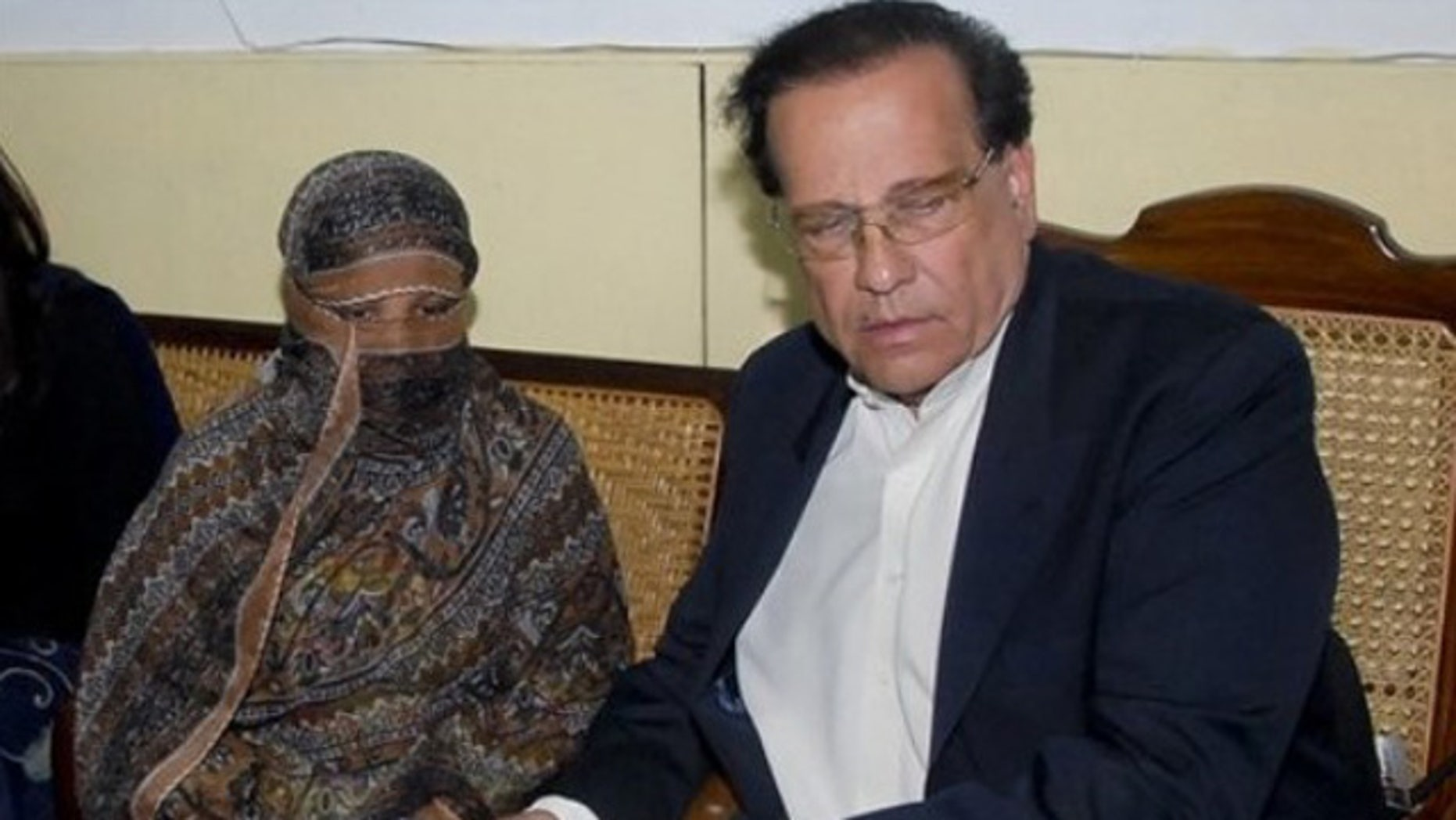 Nov. 20: Salman Taseer, right, Governor of Pakistani Punjab Province, listens to Pakistani Christian woman Asia Bibi, left, at a prison in Sheikhupura near Lahore, Pakistan.