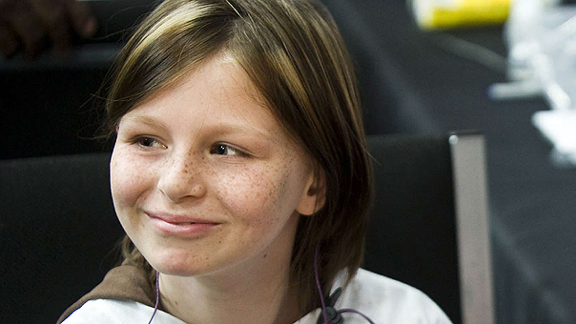 A May 2010 file photo shows Zahra Clare Baker, 10, waiting to get a hearing aid at an event at Charlotte Motor Speedway. Hickory, N.C. Hundreds of newly unsealed court documents released Tuesday Jan. 4, 2011 reveal that scrutiny in the disappearance and death of the freckle-faced Australian immigrant fell early on her stepmother and father, and has not wavered significantly since.