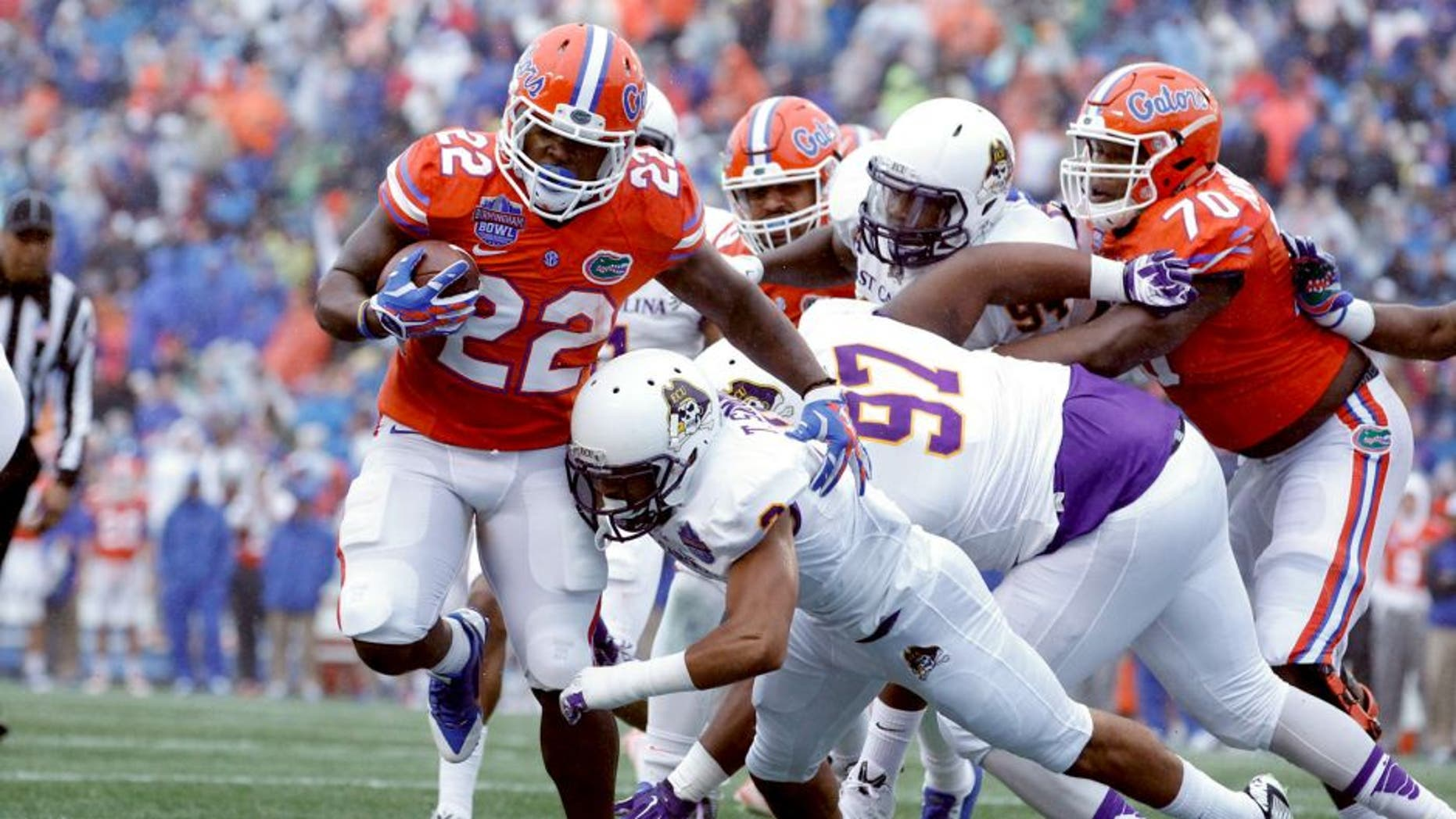Jan 3, 2015; Birmingham, AL, USA; Florida Gators running back Adam Lane (22) is hit by East Carolina Pirates defensive back Travon Simmons (3) as he scores a touchdown during the Birmingham Bowl at Legion Field. Mandatory Credit: Marvin Gentry-USA TODAY Sports
