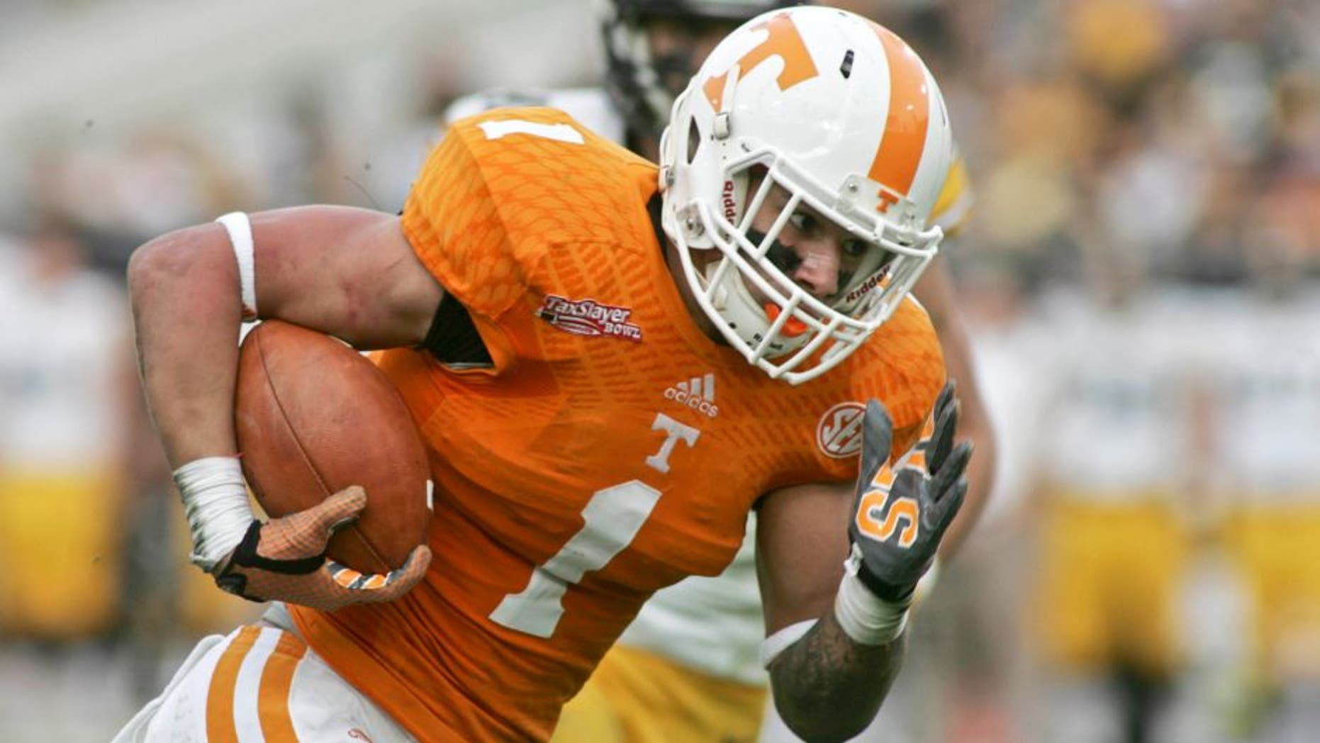 Jan 2, 2015; Jacksonville, FL, USA; Tennessee Volunteers running back Jalen Hurd (1) runs for a 29-yard touchdown in the first quarter of their 2015 TaxSlayer Bowl against the Iowa Hawkeyes at EverBank Field. Mandatory Credit: Phil Sears-USA TODAY Sports