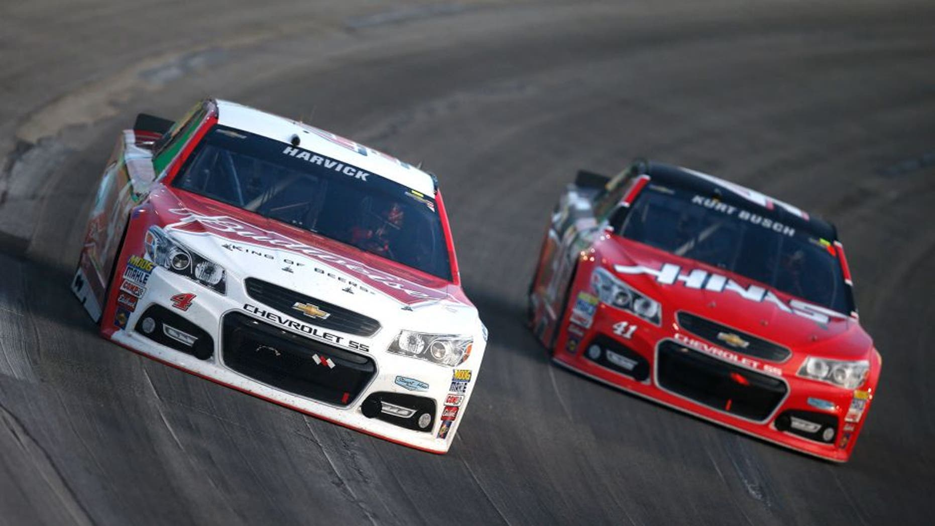 SPARTA, KY - JULY 11: Kevin Harvick, driver of the #4 Budweiser/Jimmy John's Chevrolet, and Kurt Busch, driver of the #41 Haas Automation Chevrolet, race during the NASCAR Sprint Cup Series Quaker State 400 presented by Advance Auto Parts at Kentucky Speedway on July 11, 2015 in Sparta, Kentucky. (Photo by Todd Warshaw/Getty Images)