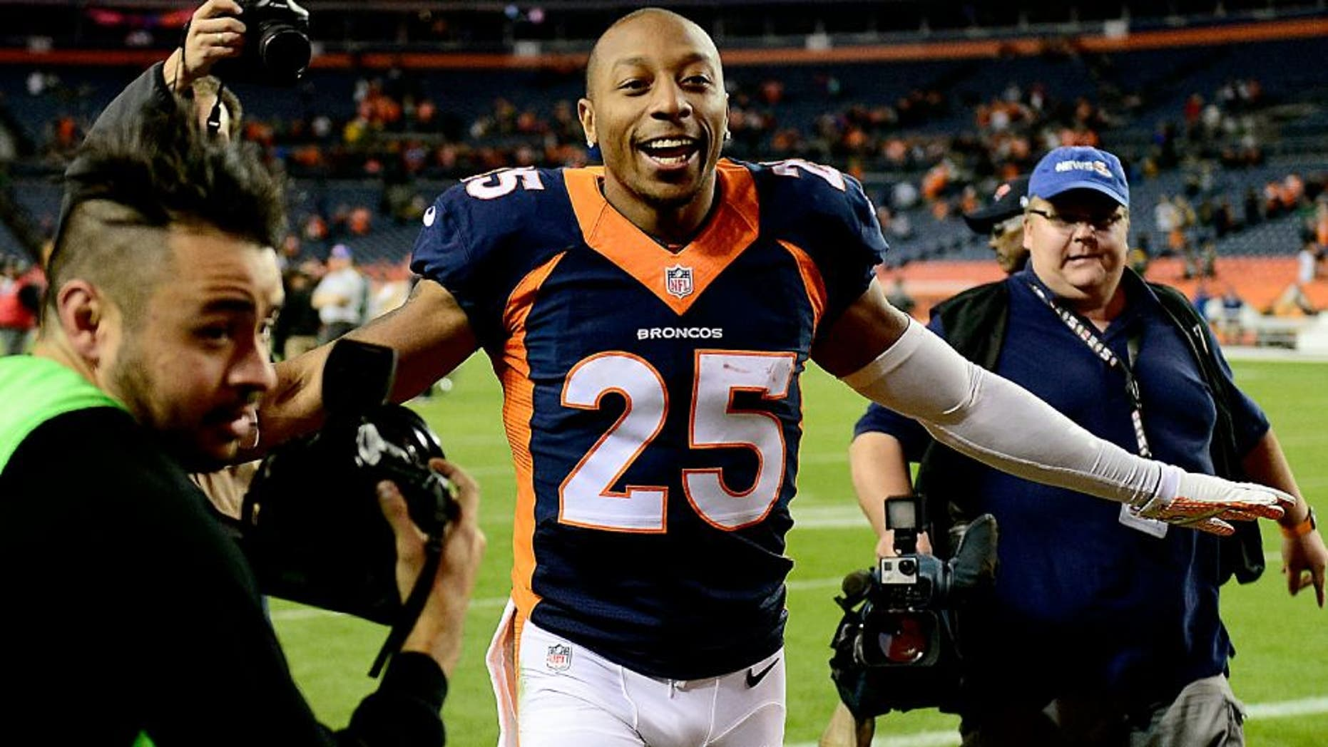 Nov 1, 2015; Denver, CO, USA; Denver Broncos cornerback Chris Harris (25) reacts following the win over the Green Bay Packers at Sports Authority Field at Mile High. The Broncos defeated the Packer 29-10. Mandatory Credit: Ron Chenoy-USA TODAY Sports