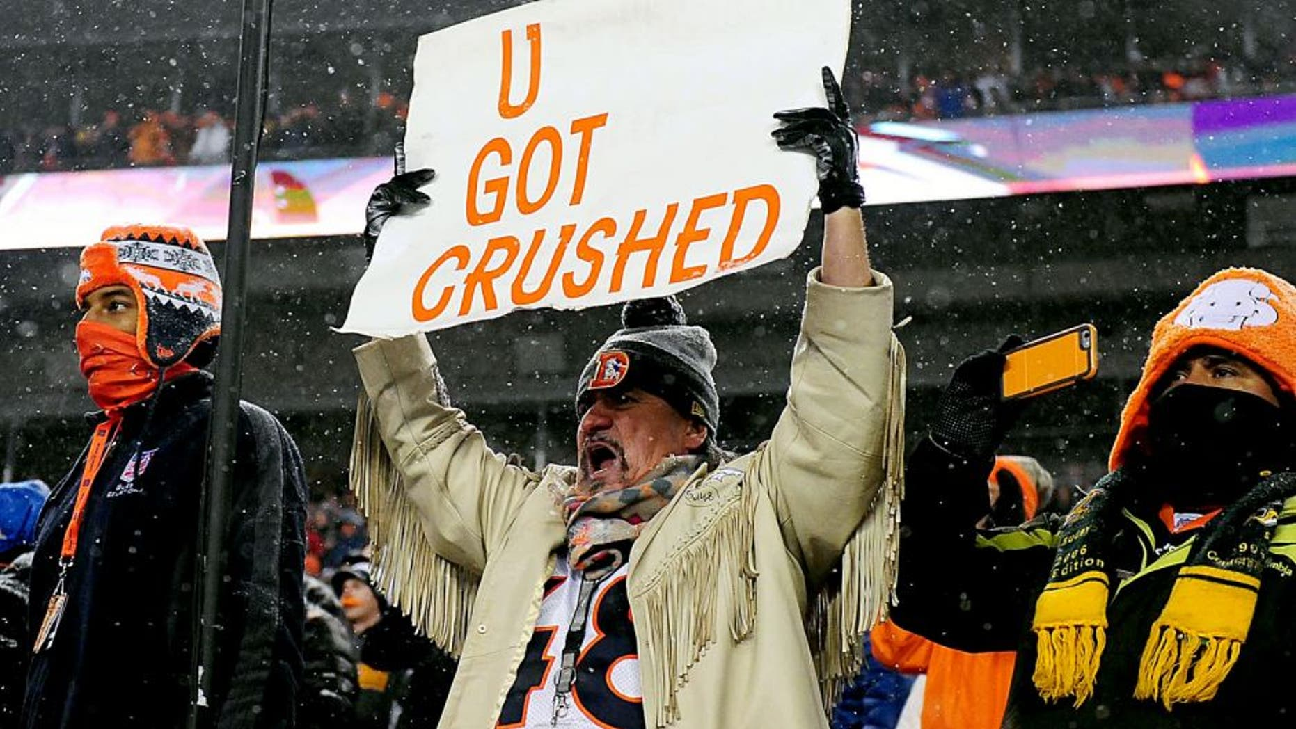 Nov 29, 2015; Denver, CO, USA; Denver Broncos fan holds a sign towards the New England Patriots bench during a overtime period at Sports Authority Field at Mile High. The Broncos defeated the Patriots 30-24 in overtime. Mandatory Credit: Ron Chenoy-USA TODAY Sports