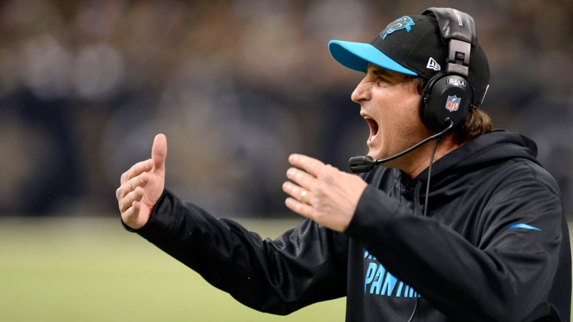Dec 30, 2012; New Orleans, LA, USA; Carolina Panthers quarterback coach Mike Shula yells to the team from the sidelines during second half of their game against the New Orleans Saints at the Mercedes-Benz Superdome. The Carolina Panthers defeated the New Orleans Saints 44-38. John David Mercer-USA TODAY Sports