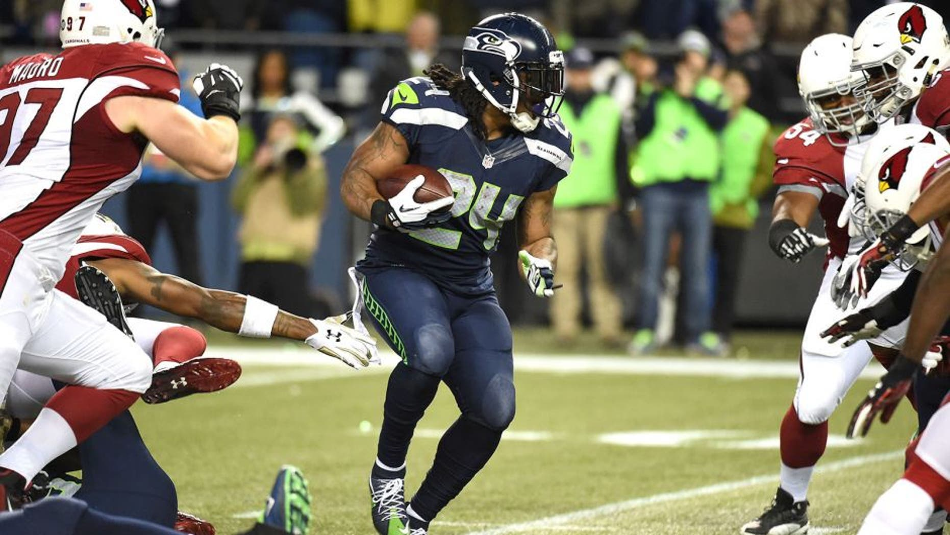 SEATTLE, WA - NOVEMBER 15: Marshawn Lynch #24 of the Seattle Seahawks carries the ball during the first half against the Arizona Cardinals at CenturyLink Field on November 15, 2015 in Seattle, Washington. (Photo by Steve Dykes/Getty Images)