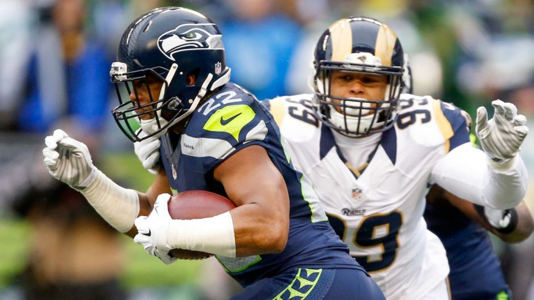 Dec 27, 2015; Seattle, WA, USA; Seattle Seahawks running back Fred Jackson (22) is tackled by St. Louis Rams defensive tackle Aaron Donald (99) during the first quarter at CenturyLink Field. Mandatory Credit: Joe Nicholson-USA TODAY Sports