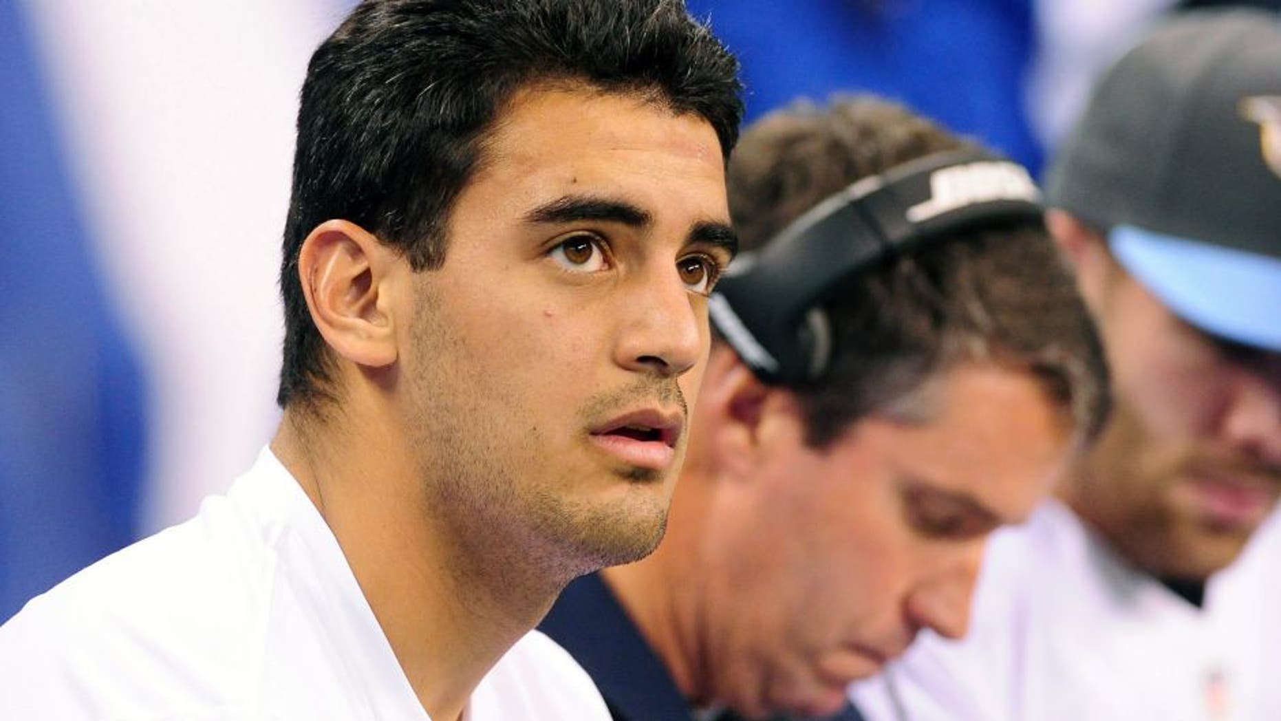 Jan 3, 2016; Indianapolis, IN, USA; Tennessee Titans quarterback Marcus Mariota (8) watches from the sidelines against the Indianapolis Colts at Lucas Oil Stadium. Mandatory Credit: Thomas J. Russo-