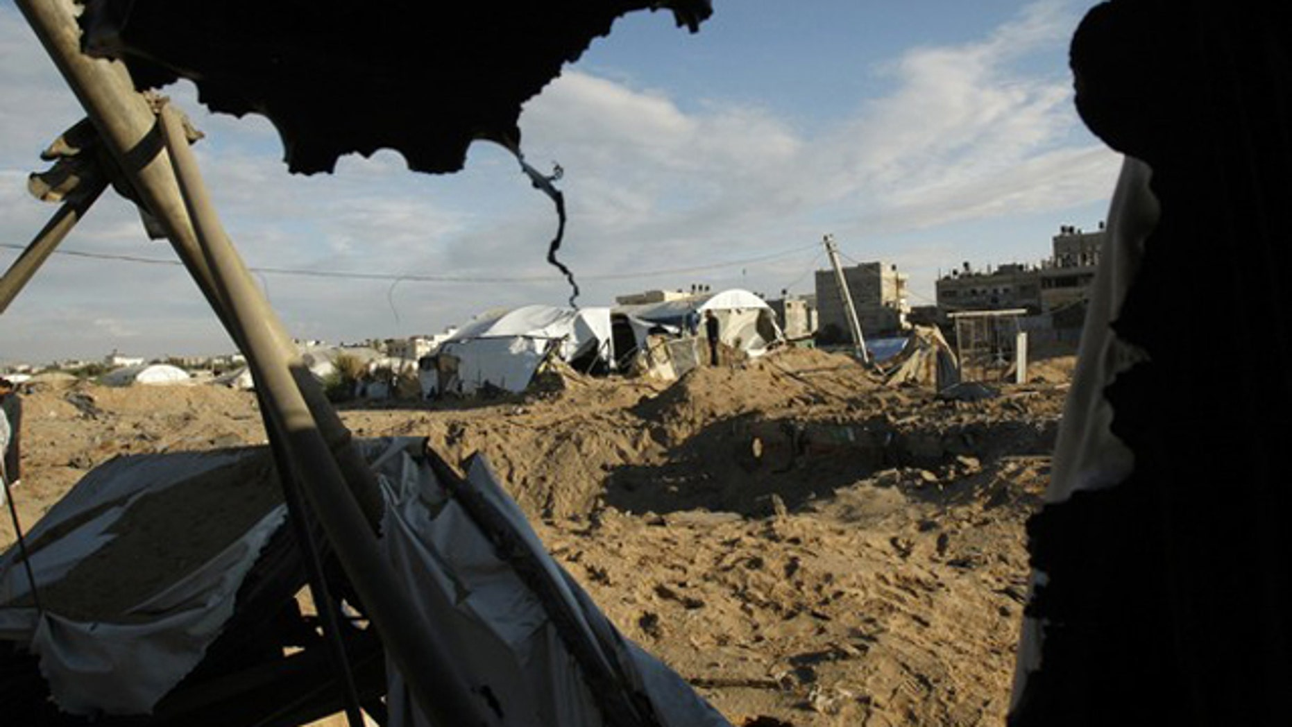 Jan. 5: Palestinians survey the damage after an Israeli air strike on a smuggling tunnel in the southern Gaza Strip, along the Gaza-Egypt border.