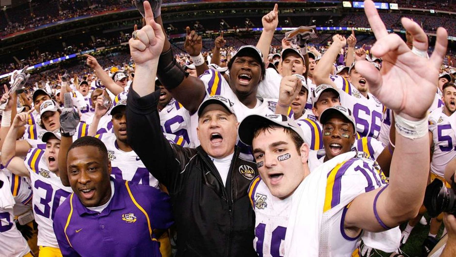 NEW ORLEANS - JANUARY 07: Head coach Les Miles of the Louisiana State University Tigers celebrates with his team after defeating the Ohio State Buckeyes 38-24 in the AllState BCS National Championship on January 7, 2008 at the Louisiana Superdome in New Orleans, Louisiana. (Photo by Chris Graythen/Getty Images)