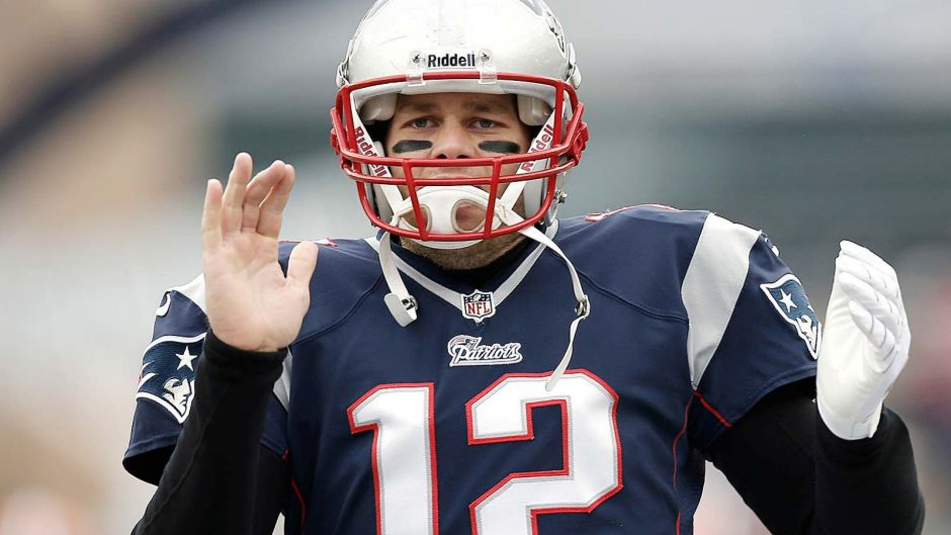 Dec 8, 2013; Foxborough, MA, USA; New England Patriots quarterback Tom Brady (12) takes the field before the game against the Cleveland Browns at Gillette Stadium. Mandatory Credit: Winslow Townson-USA TODAY Sports