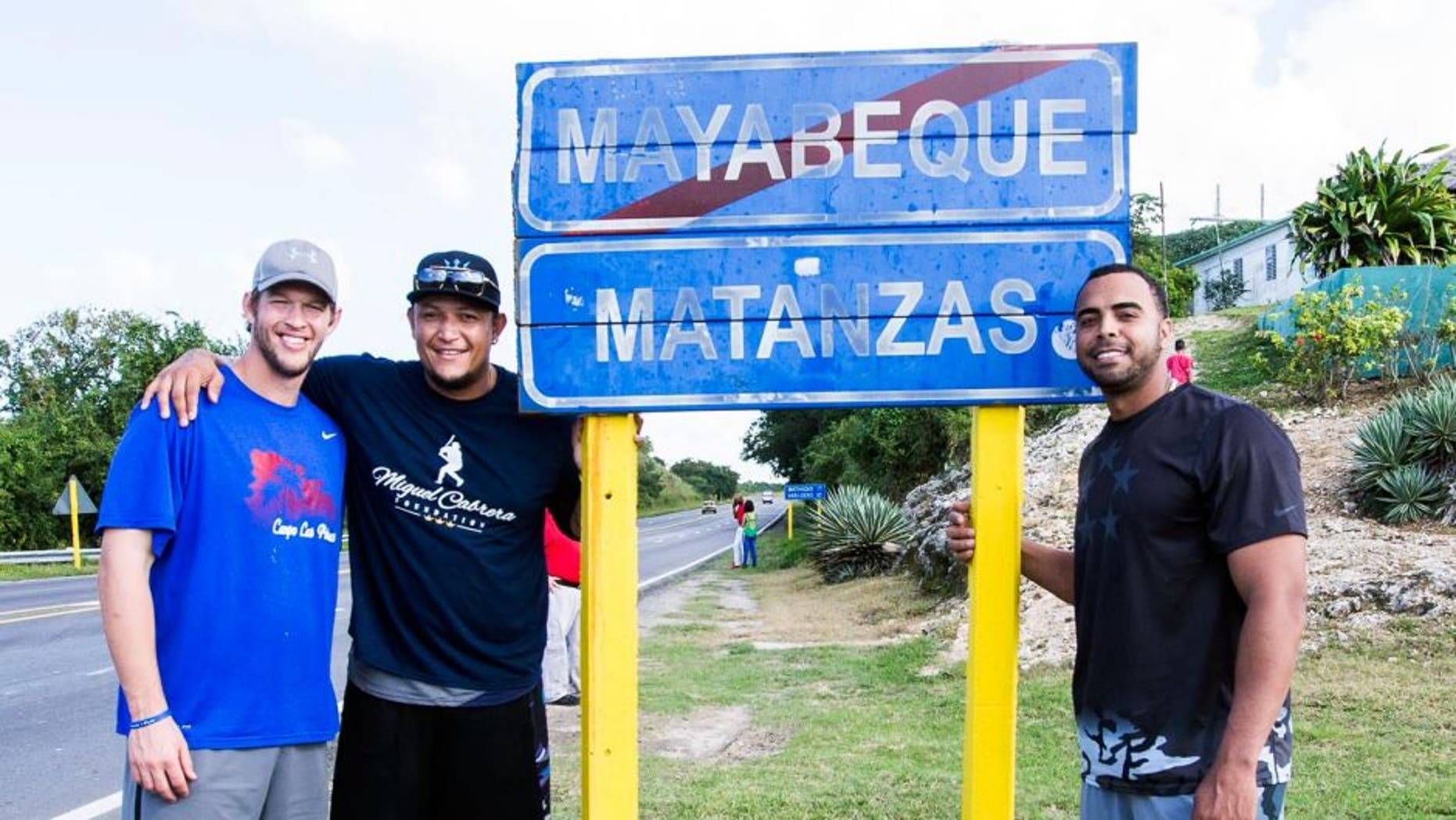 MATANZAS, CUBA - DECEMBER 17: Clayton Kershaw of the Los Angeles Dodgers, Miguel Cabrera of the Detroit Tigers, and Nelson Cruz of the Seattle Mariners pose for a photo on their way to a youth baseball clinic during an MLB goodwill tour on December 17, 2015 at Estadio Victoria de Giron in Matanzas, Cuba. (Photo by Rob Tringali/MLB Photos via Getty Images)
