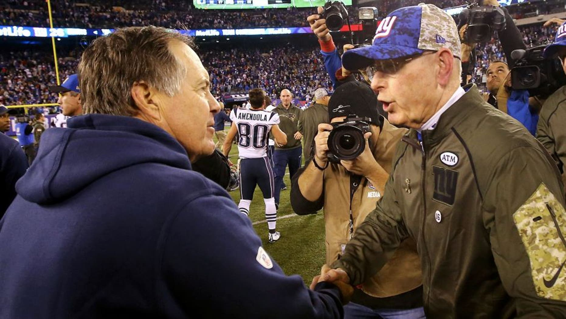 EAST RUTHERFORD, NJ - NOVEMBER 15: Head Coach Tom Coughlin of the New York Giants meets head coach Bill Belichick of the New England Patriots after the Patriots 27-26 win at MetLife Stadium on November 15, 2015 in East Rutherford, New Jersey. (Photo by Al Bello/Getty Images)