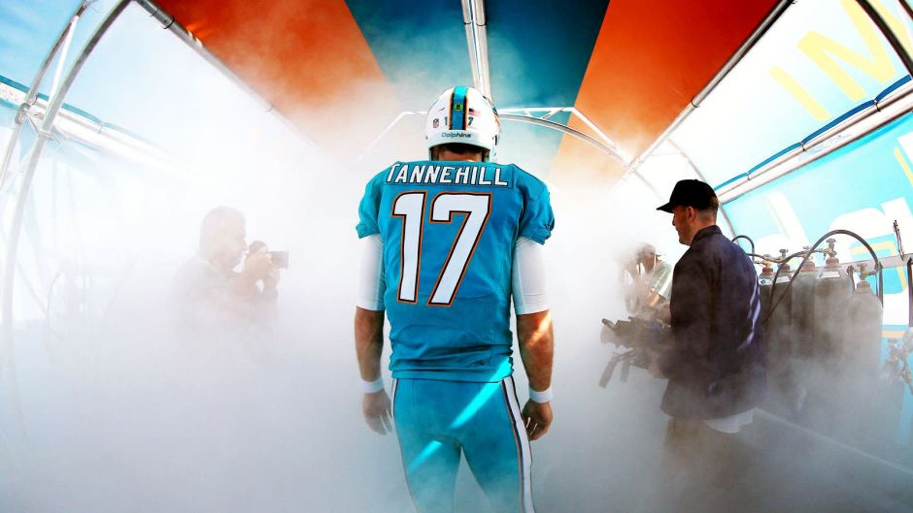 MIAMI GARDENS, FL - JANUARy 03: Ryan Tannehill #17 of the Miami Dolphins prepares to take the field before the game against the New England Patriots at Sun Life Stadium on January 3, 2016 in Miami Gardens, Florida. (Photo by Mike Ehrmann/Getty Images)