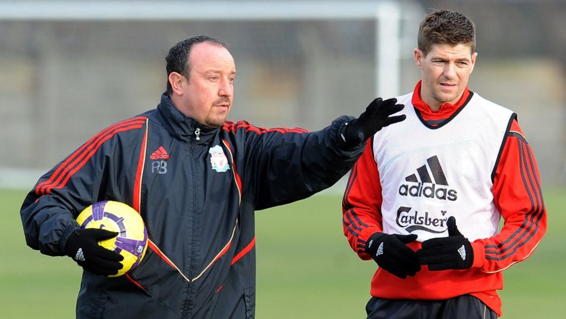 LIVERPOOL, ENGLAND - FEBRUARY 05: (THE SUN OUT) Liverpool Manager Rafael Benitez talks with Steven Gerrard during a Liverpool FC training session at Melwood Training Ground on February 5, 2010 in Liverpool, England. (Photo by John Powell/Liverpool FC via Getty Images)
