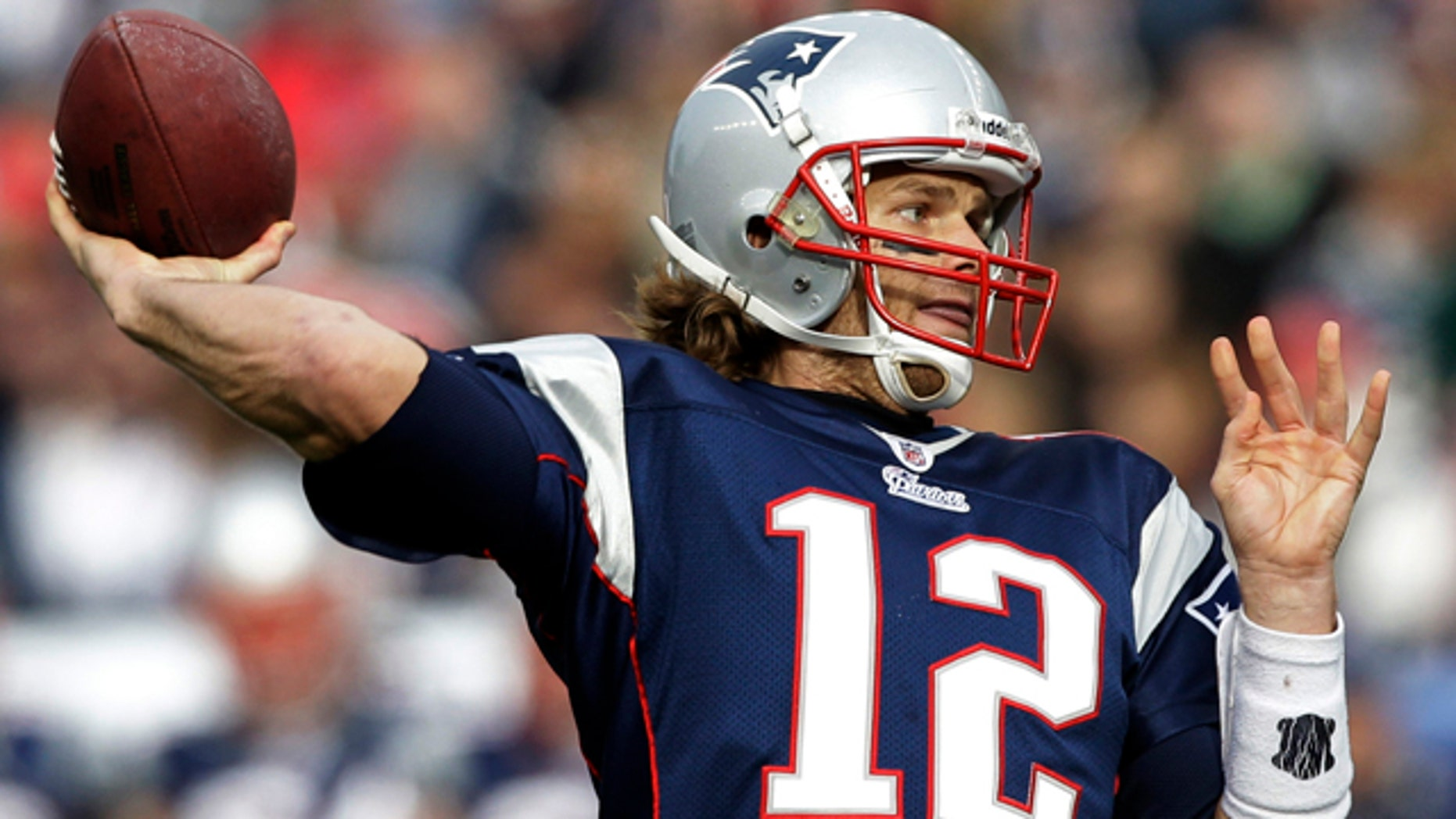 Jan. 2: New England Patriots quarterback Tom Brady passes during the first quarter of an NFL football game against the Miami Dolphins in Foxborough, Mass.
