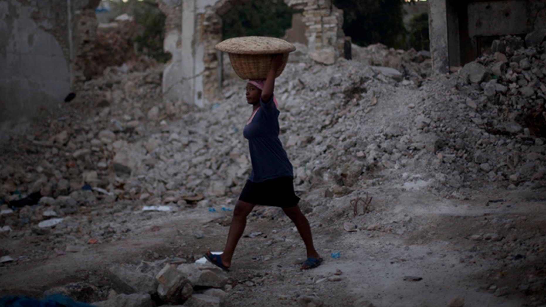 Jan. 5: A woman walks through the rubble of quake-damaged buildings in downtown Port-au-Prince, Haiti.