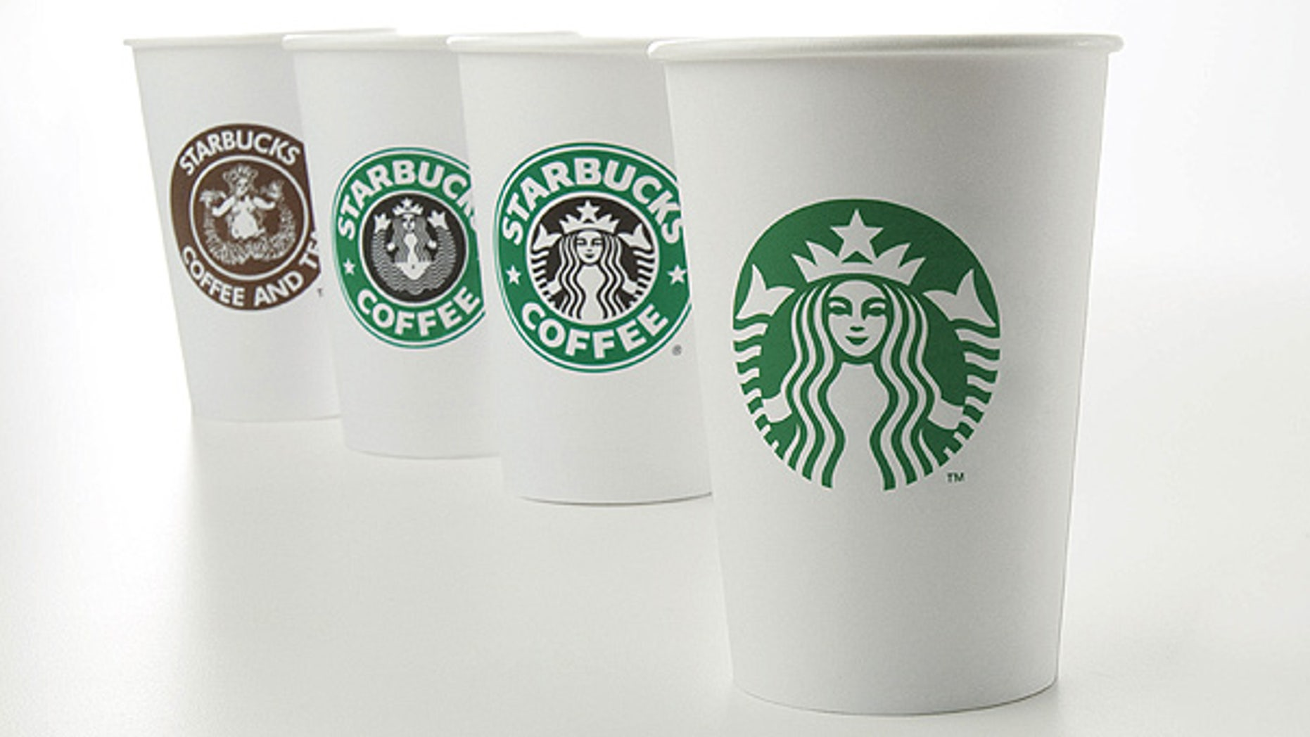 Starbucks' new 40-year anniversary logo is seen on a cup at right. The coffee giant is testing a new, super-expensive Costa Rica Finca Palmilera brew that sells for $7 a pop.