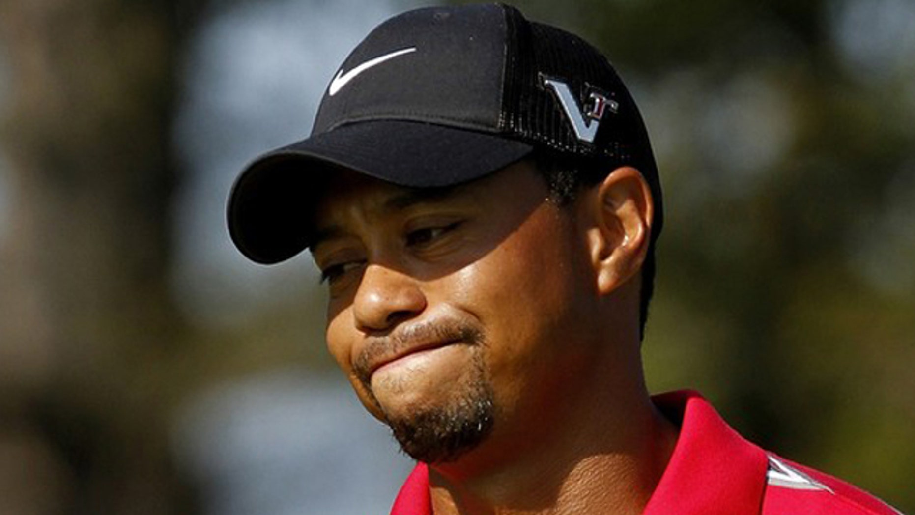 Aug. 8: Tiger Woods reacts after missing a putt during the WGC Bridgestone Invitational golf tournament in Akron, Ohio.