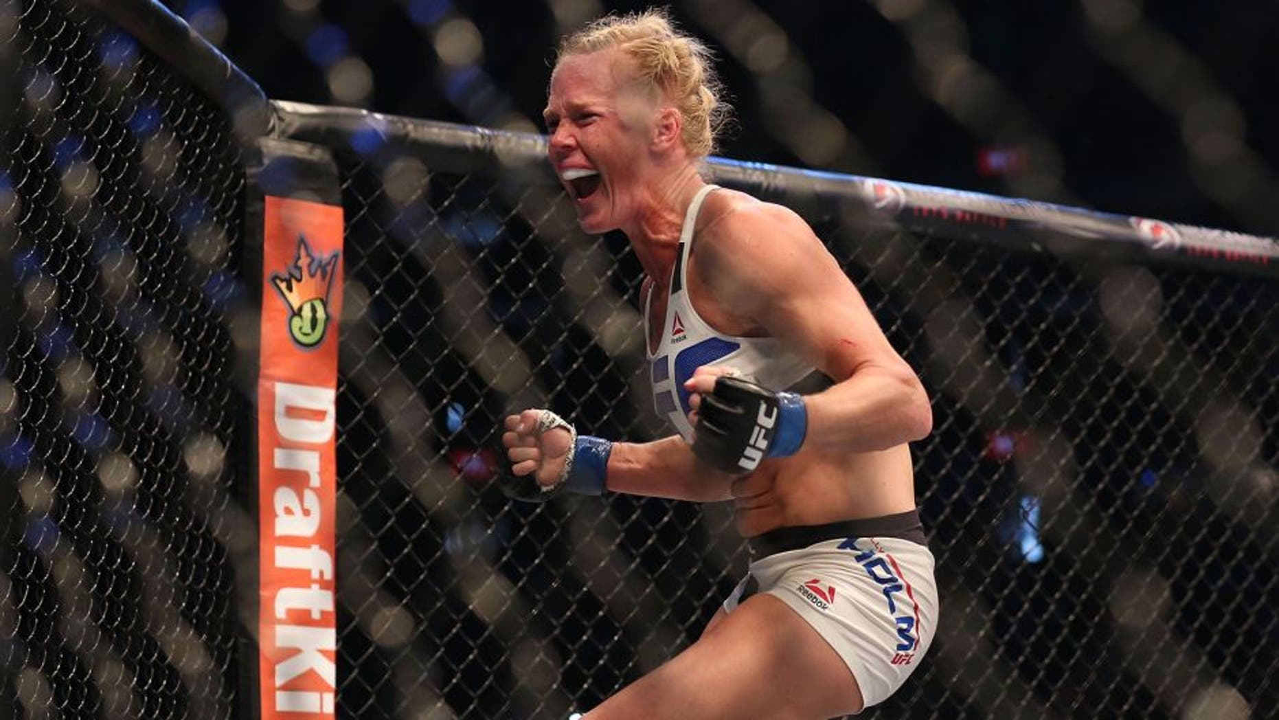 MELBOURNE, AUSTRALIA - NOVEMBER 15: Holly Holm of the United States celebrates victory over Ronda Rousey of the United States in their UFC women's bantamweight championship bout during the UFC 193 event at Etihad Stadium on November 15, 2015 in Melbourne, Australia. (Photo by Quinn Rooney/Getty Images)