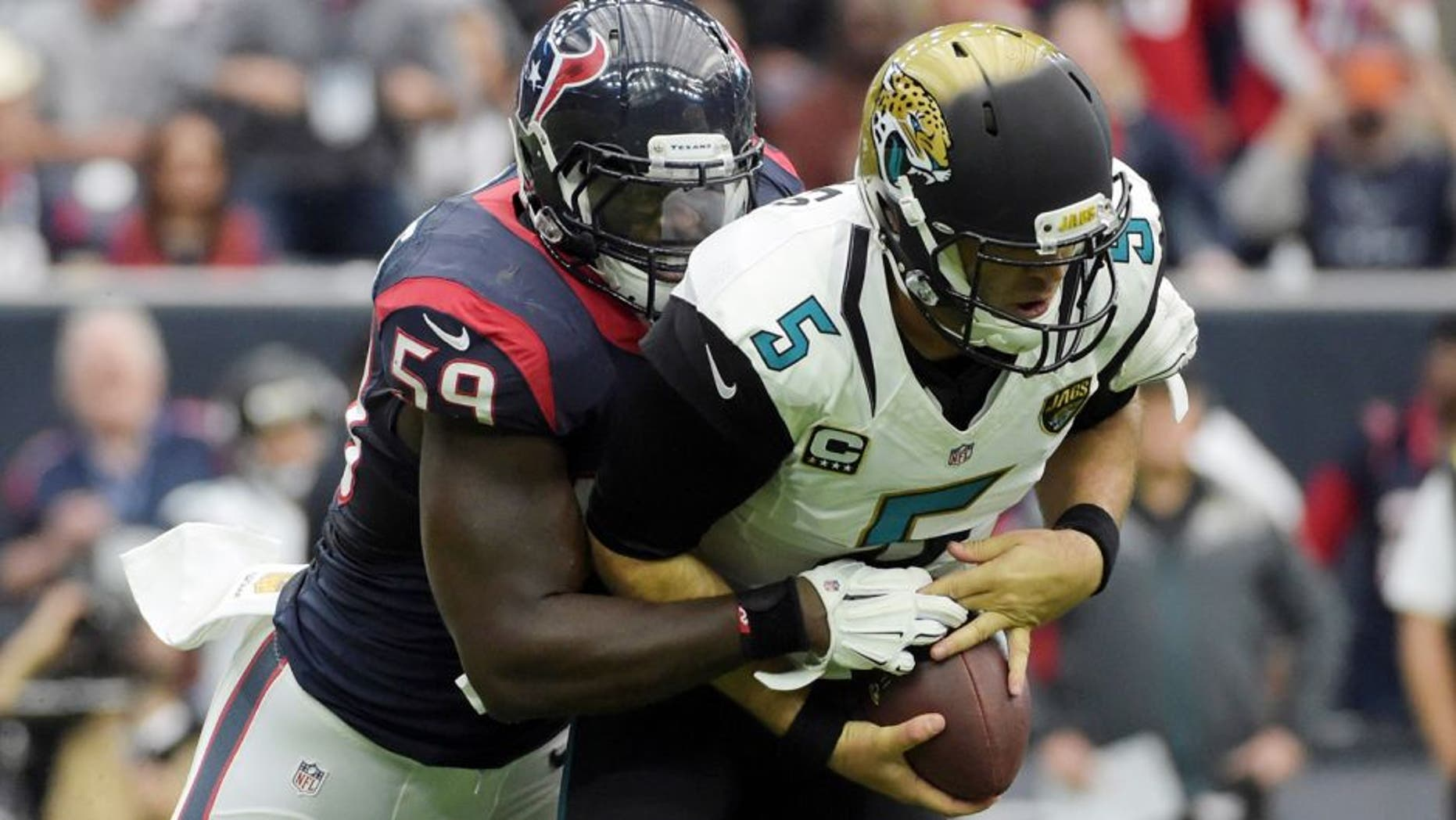 Jan 3, 2016; Houston, TX, USA; Houston Texans outside linebacker Whitney Mercilus (59) sacks Jacksonville Jaguars quarterback Blake Bortles (5) during an NFL football game at NRG Stadium. Mandatory Credit: Kirby Lee-USA TODAY Sports