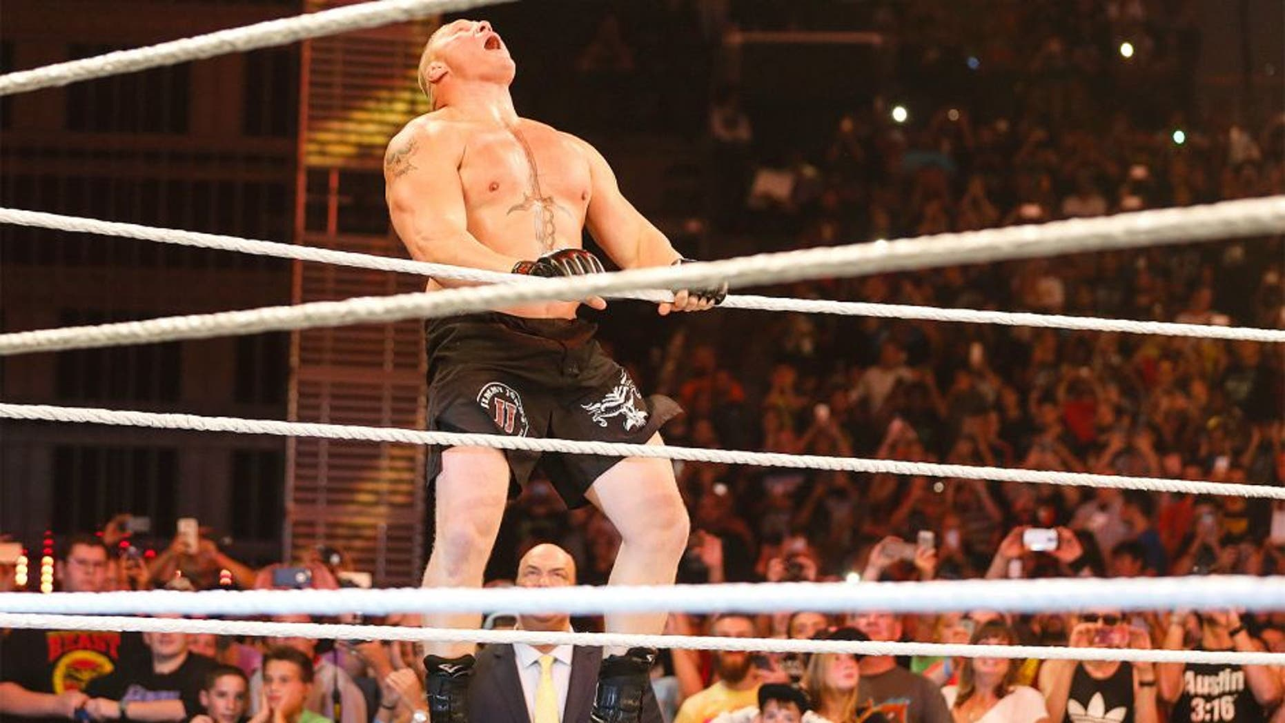 NEW YORK, NY - AUGUST 23: Brock Lesnar enters the ring at the WWE SummerSlam 2015 at Barclays Center of Brooklyn on August 23, 2015 in New York City. (Photo by JP Yim/Getty Images)