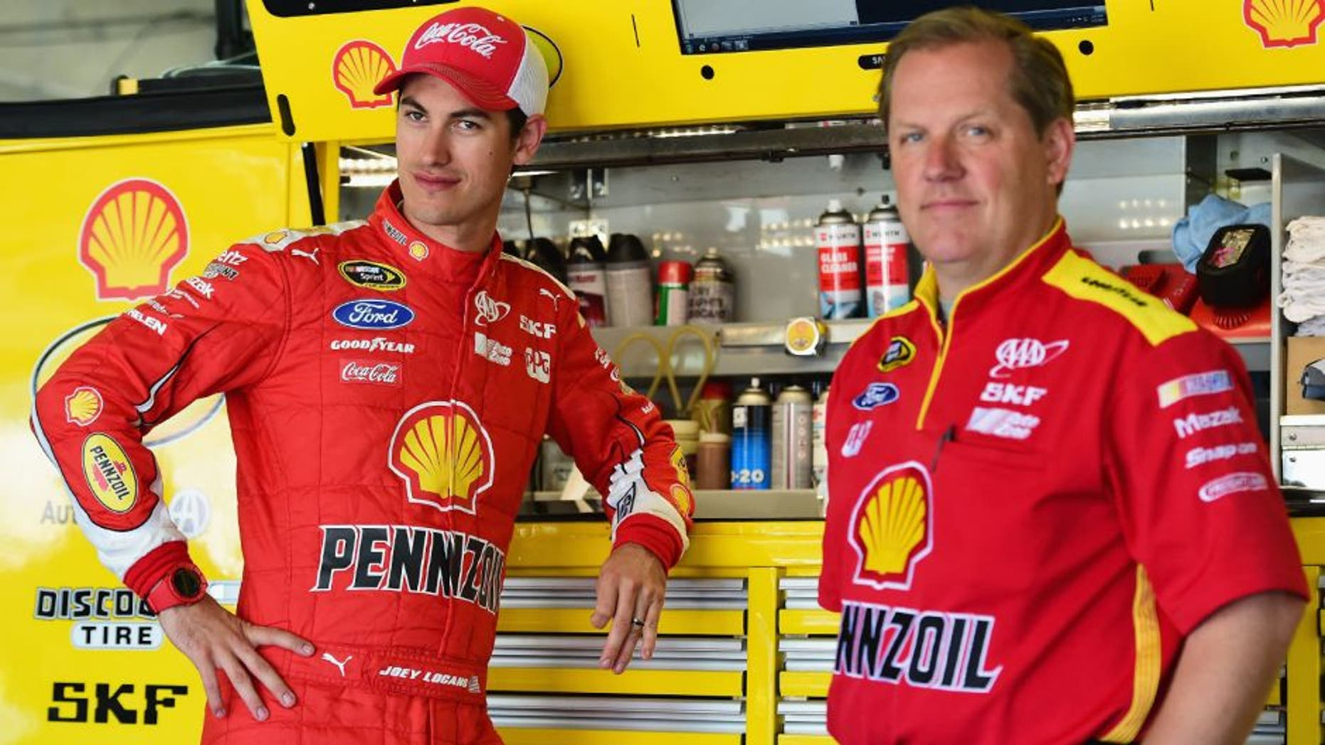 CHARLOTTE, NC - MAY 23: Joey Logano, driver of the #22 Shell Pennzoil Ford, stands in the garage area with his crew chief Todd Gordon during practice for the NASCAR Sprint Cup Series Coca-Cola 600 at Charlotte Motor Speedway on May 23, 2015 in Charlotte, North Carolina. (Photo by Jared C. Tilton/Getty Images)
