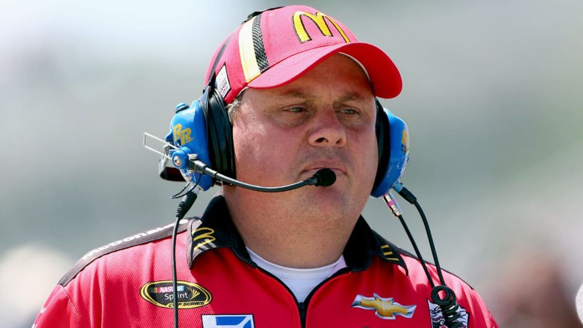 WATKINS GLEN, NY - AUGUST 10: Kevin Manion, crew chief of the #1 McDonald's/Monopoly Chevrolet, during qualifying for the NASCAR Sprint Cup Series Cheez-It 355 at The Glen at Watkins Glen International on August 10, 2013 in Watkins Glen, New York. (Photo by Todd Warshaw/Getty Images)