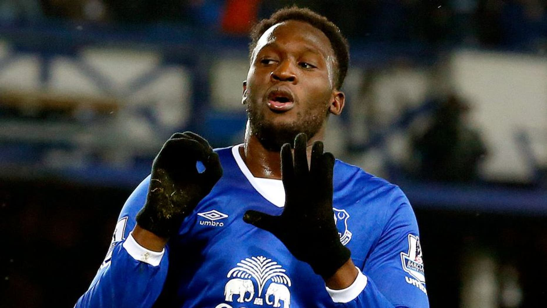 Everton's Belgian striker Romelu Lukaku celebrates scoing his team's first goal during the English Premier League football match between Everton and Crystal Palace at Goodison Park in Liverpool on December 7, 2015. AFP PHOTO / LINDESY PARNABY RESTRICTED TO EDITORIAL USE. No use with unauthorized audio, video, data, fixture lists, club/league logos or 'live' services. Online in-match use limited to 75 images, no video emulation. No use in betting, games or single club/league/player publications. / AFP / LINDSEY PARNABY (Photo credit should read LINDSEY PARNABY/AFP/Getty Images)