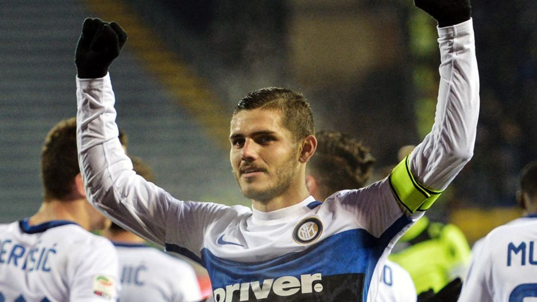 "Inter Milan's forward from Argentina Mauro Icardi celebrates after scoring during the Italian Serie A football match Empoli vs Inter Milan, on January 6, 2016 at Empoli's ""Carlo Castellani"" comunal stadium. AFP PHOTO / ANDREAS SOLARO / AFP / ANDREAS SOLARO (Photo credit should read ANDREAS SOLARO/AFP/Getty Images)"