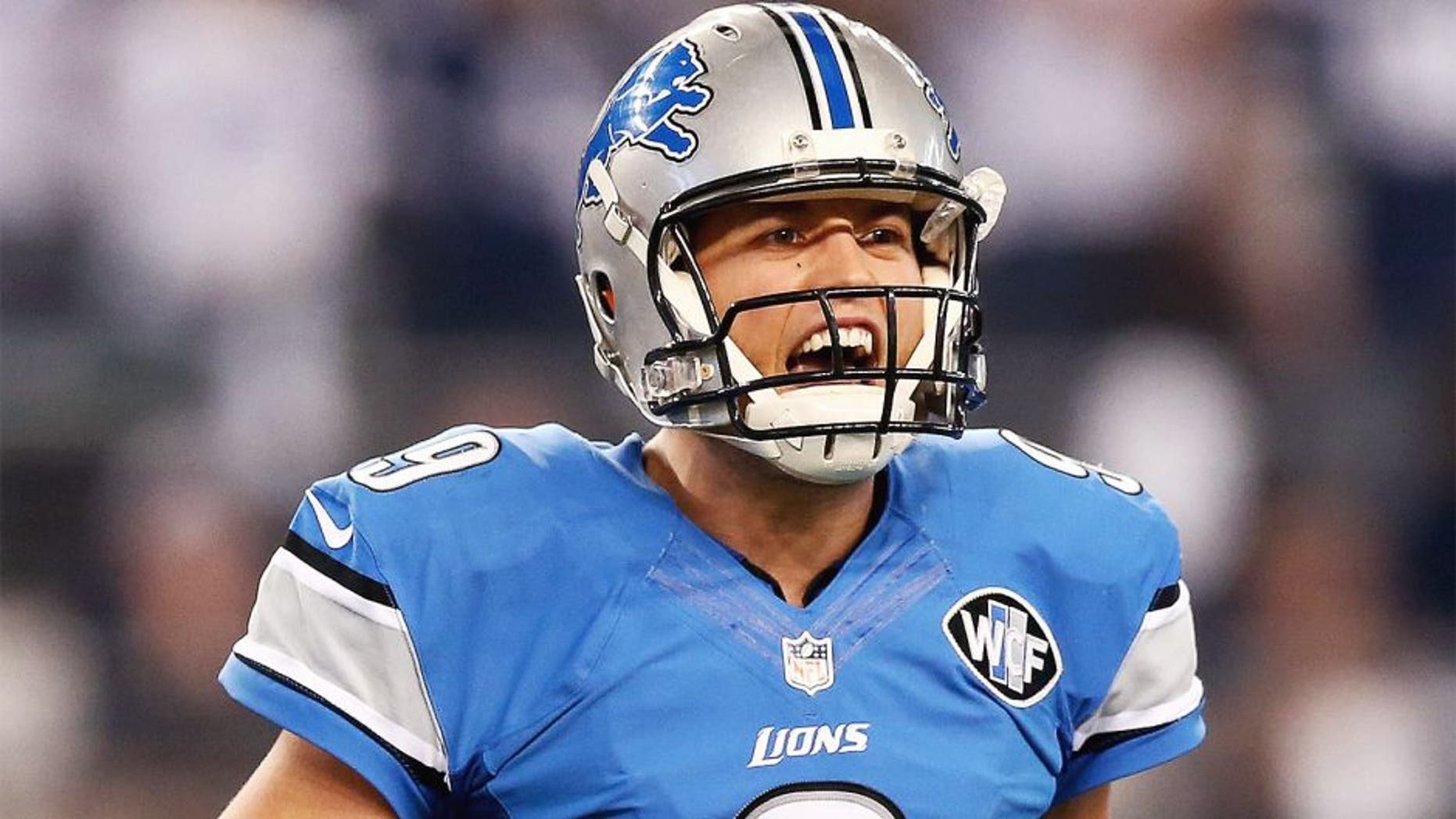 ARLINGTON, TX - JANUARY 04: Quarterback Matthew Stafford #9 of the Detroit Lions reacts in the first half while taking on the Dallas Cowboys during the NFC Wildcard Playoff Game at AT&T Stadium on January 4, 2015 in Arlington, Texas. (Photo by Ronald Martinez/Getty Images)