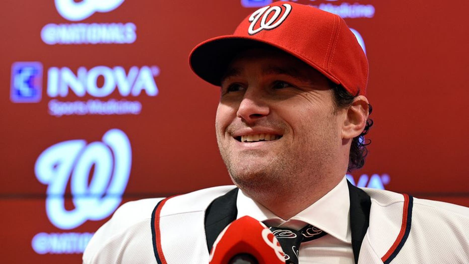New Washington Nationals infielder Daniel Murphy speaks during a news conference at Nationals Park in Washington, Thursday, Jan. 7, 2016. Murphy's three-year contract with the Nationals will cost the team only $8 million in 2016. (AP Photo/Susan Walsh)