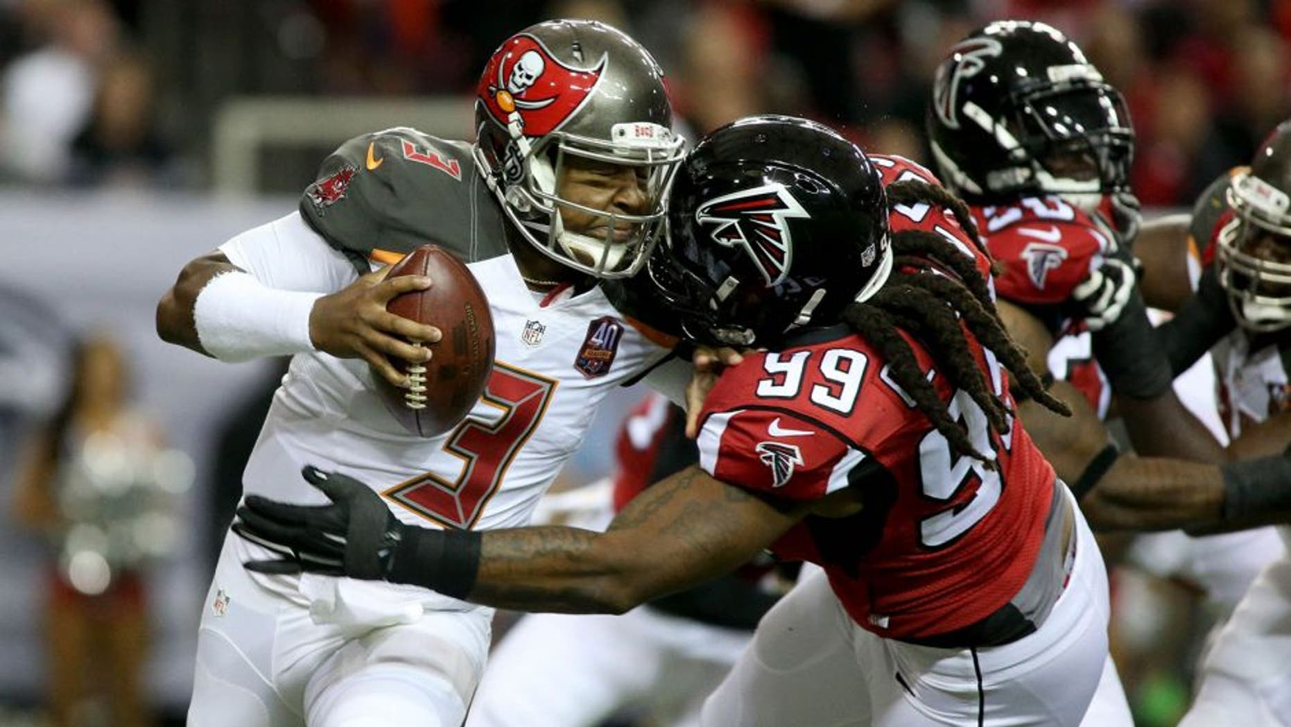 Nov 1, 2015; Atlanta, GA, USA; Tampa Bay Buccaneers quarterback Jameis Winston (3) is hit by Atlanta Falcons defensive end Adrian Clayborn (99) but prevents the tackle from Clayborn in the first quarter of their game at the Georgia Dome. Mandatory Credit: Jason Getz-USA TODAY Sports