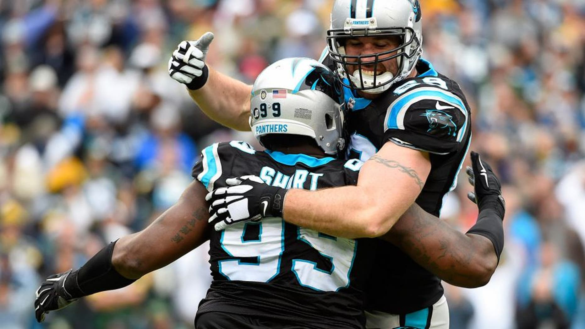 Nov 8, 2015; Charlotte, NC, USA; Carolina Panthers defensive tackle Kawann Short (99) celebrates with defensive end Jared Allen (69) after sacking Green Bay Packers quarterback Aaron Rodgers (12) (not pictured) in the second quarter at Bank of America Stadium. Mandatory Credit: Bob Donnan-USA TODAY Sports