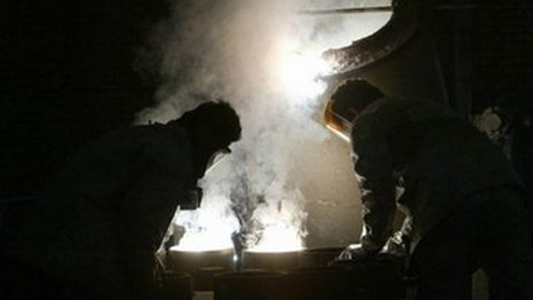 Jan. 8: Two Iranian technicians at the zirconium production plant inside the Isfahan nuclear facility.