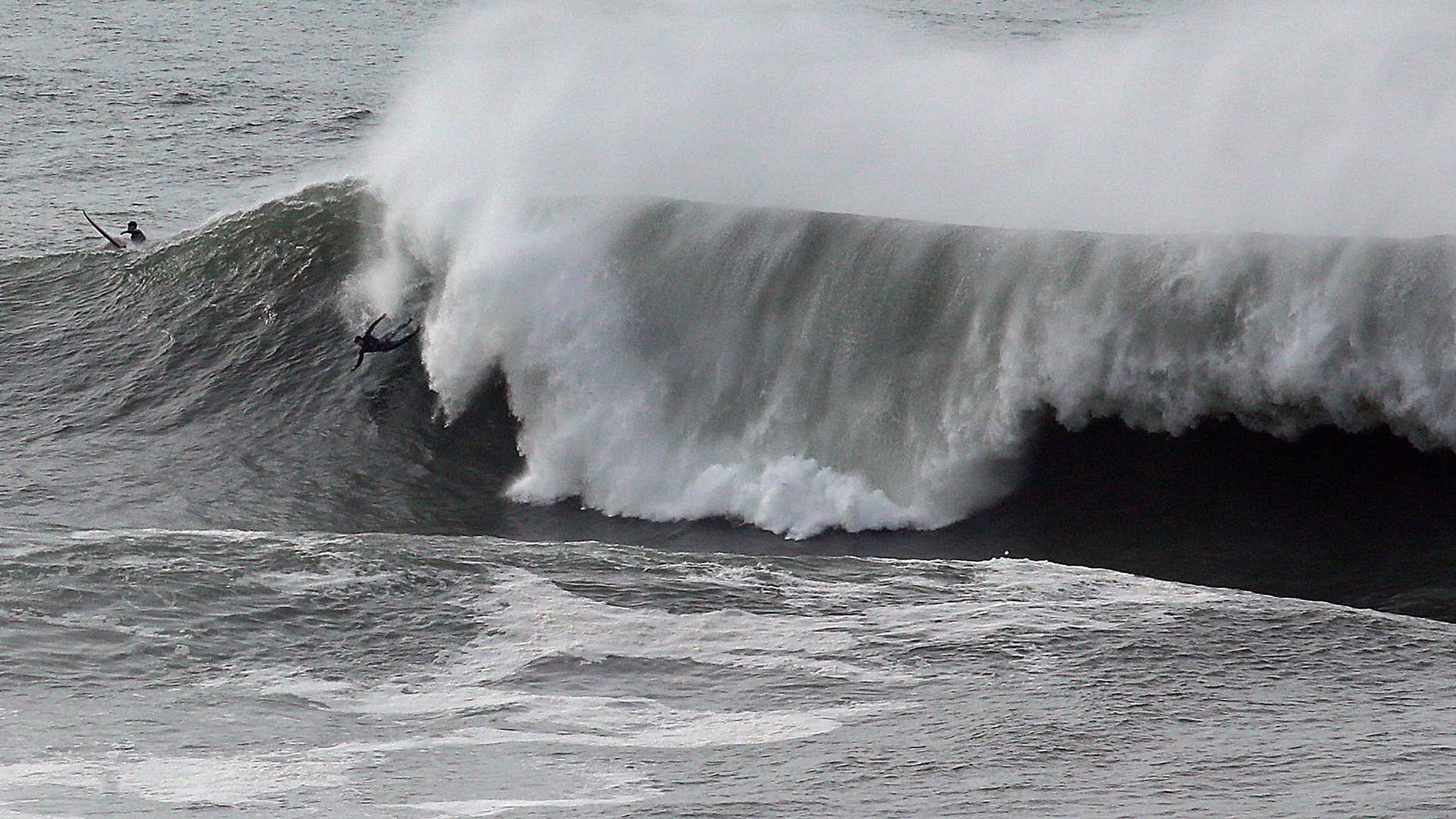 Jan. 8, 2016: A surfer wipes out under a large wave at Mavericks in Half Moon Bay, Calif.