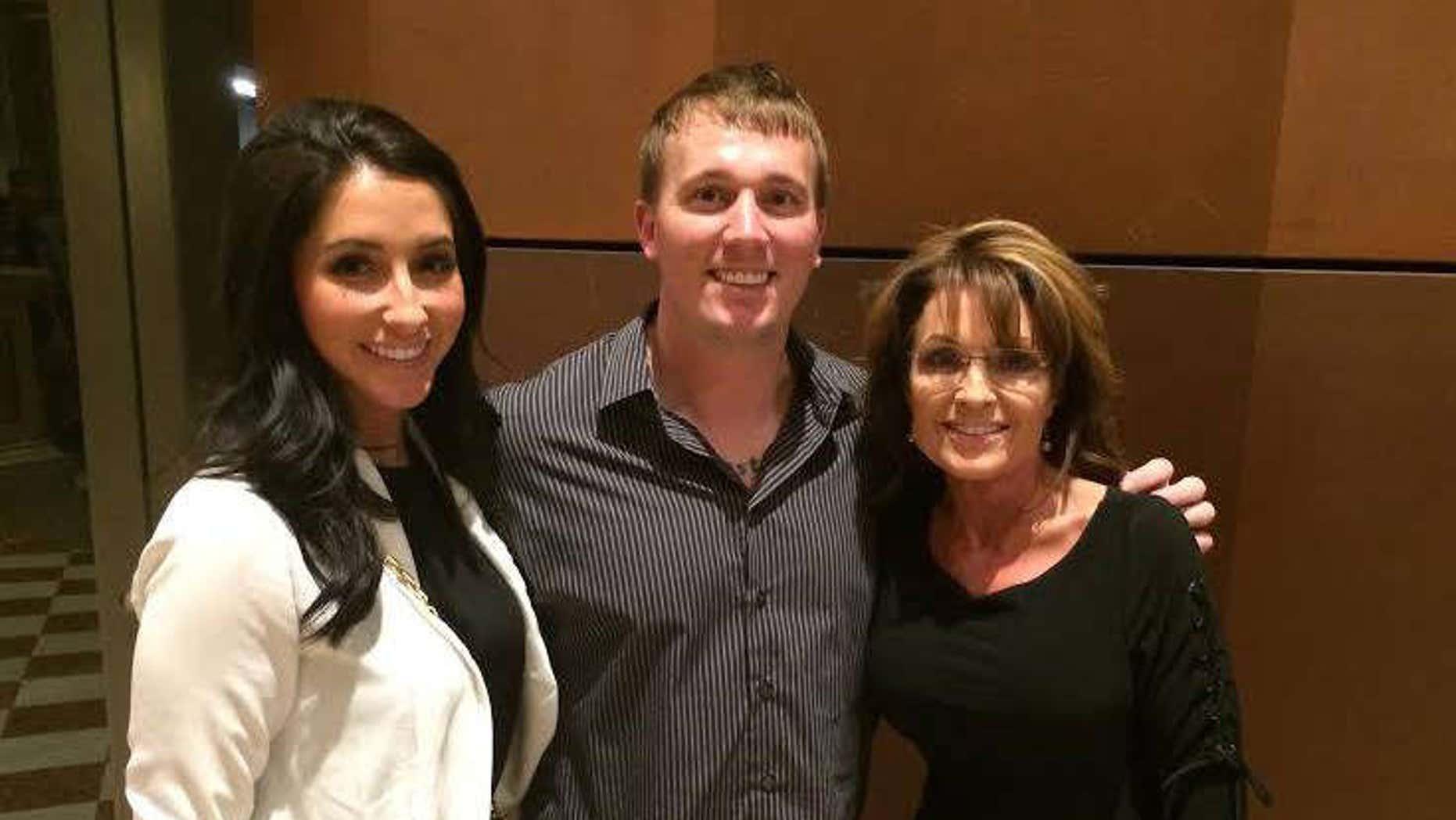 Jan. 26, 2015: Bristol Palin and Dakota Meyer pose with Sarah Palin.