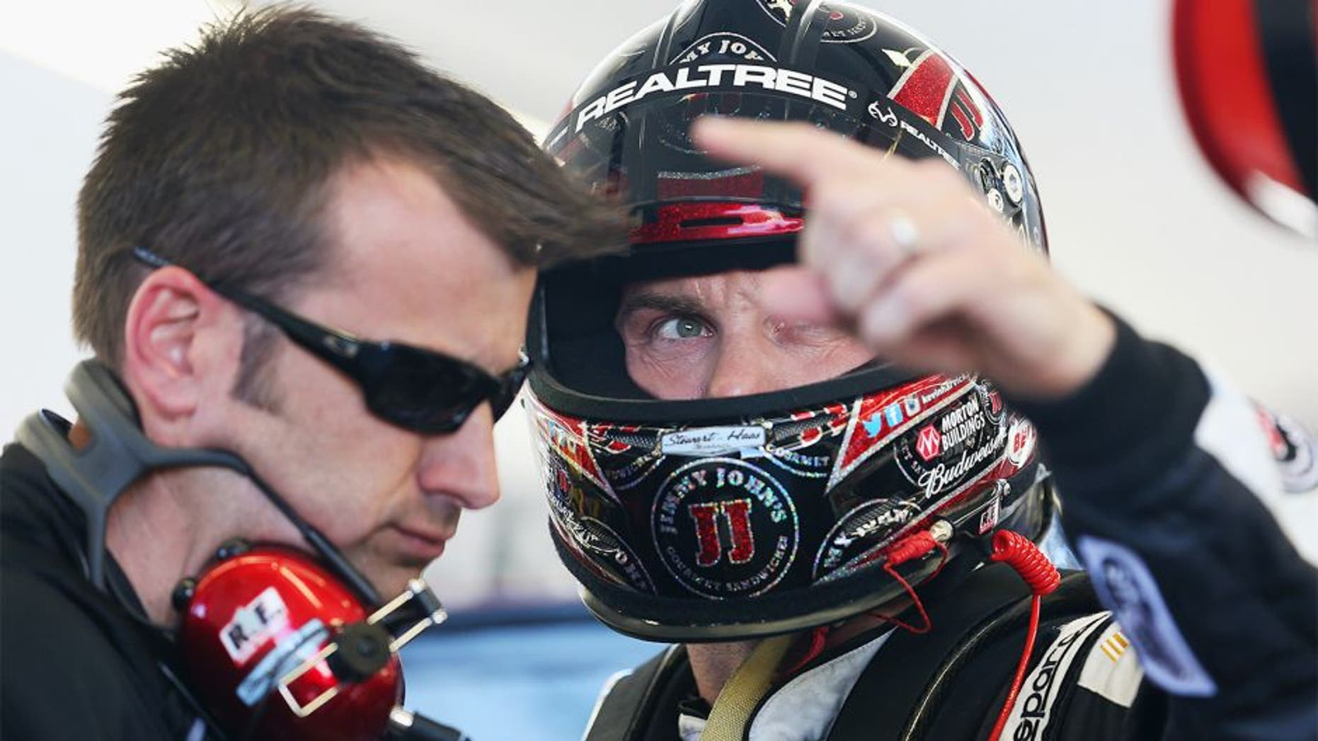 LAS VEGAS, NV - MARCH 07: Kevin Harvick (right), driver of the #4 Jimmy John's Chevrolet, speaks with his crew chief Rodney Childers during practice for the NASCAR Sprint Cup Series Kobalt 400 at Las Vegas Motor Speedway on March 7, 2014 in Las Vegas, Nevada. (Photo by Nick Laham/Getty Images)